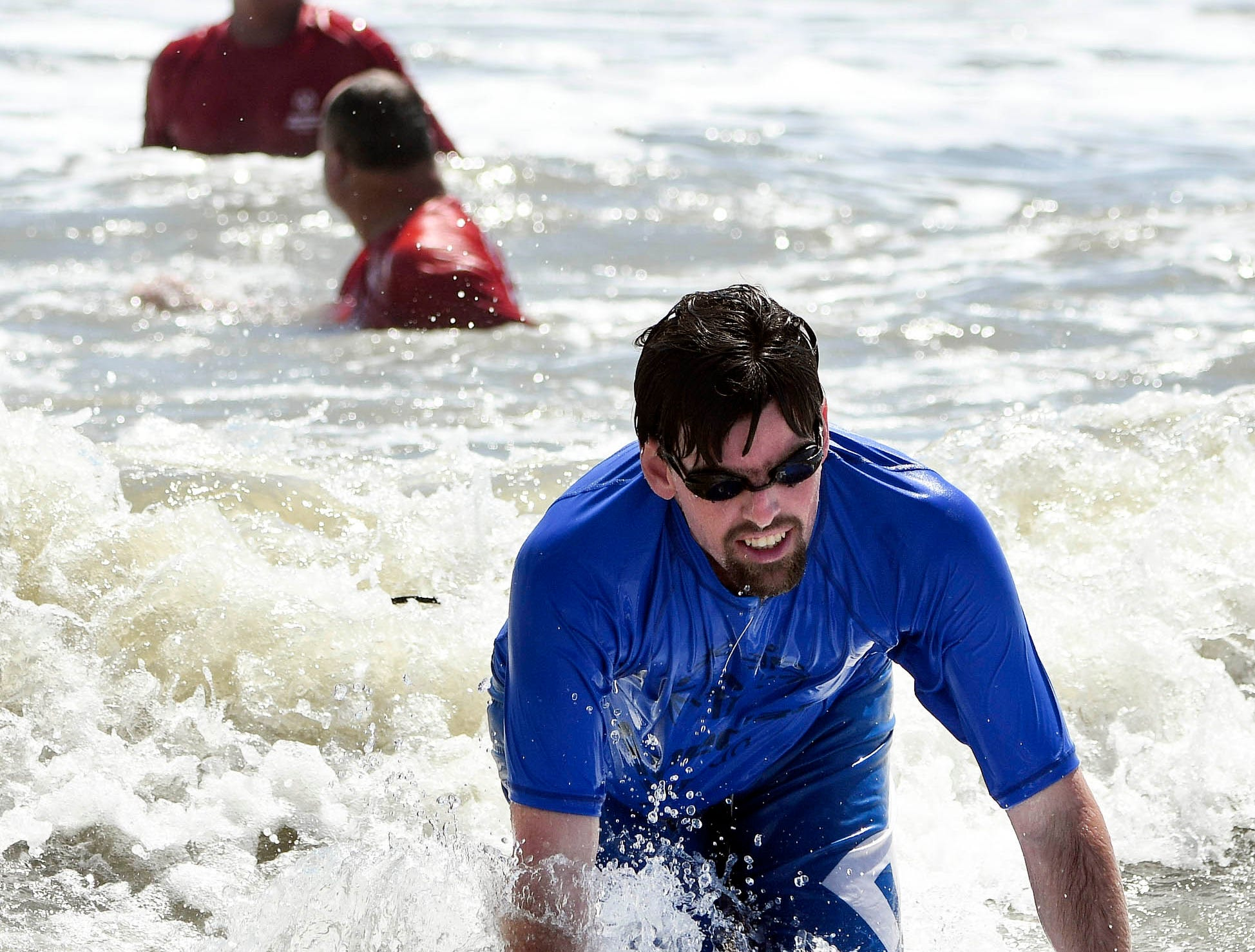 Bryan Padron rides a wave during the Special Olympics Florida spring surfing festival Saturday at Shepard Park in Cocoa Beach.