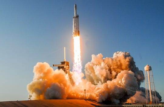 A SpaceX Falcon Heavy lifts off from Pad 39A at Kennedy Space Center Thursday evening. The rocket is carrying the Arabsat 6A communications satellite for Saudi Arabia.