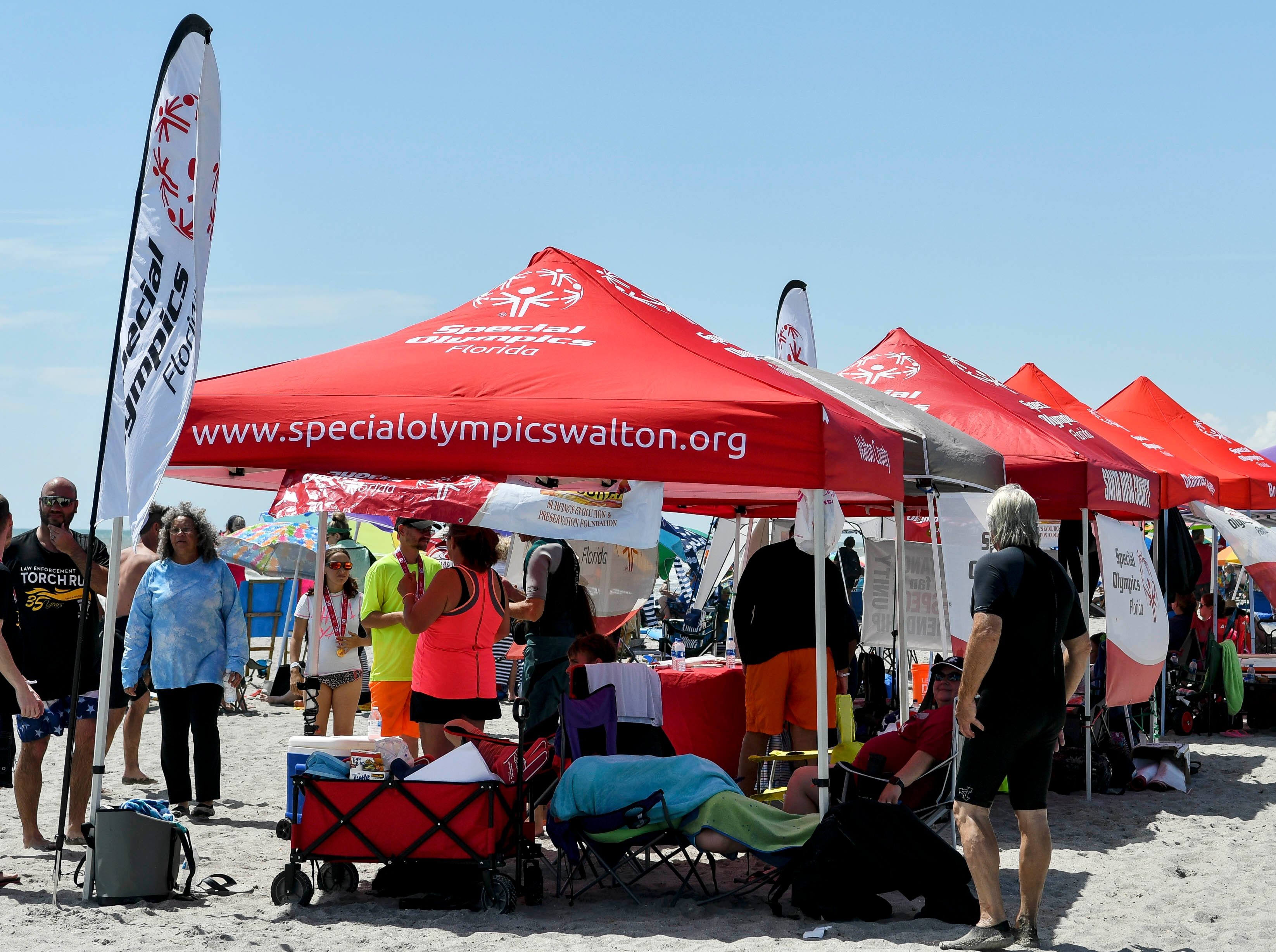 Participants from around the state gather for the Special Olympics Florida spring surfing festival at Shepard Park.