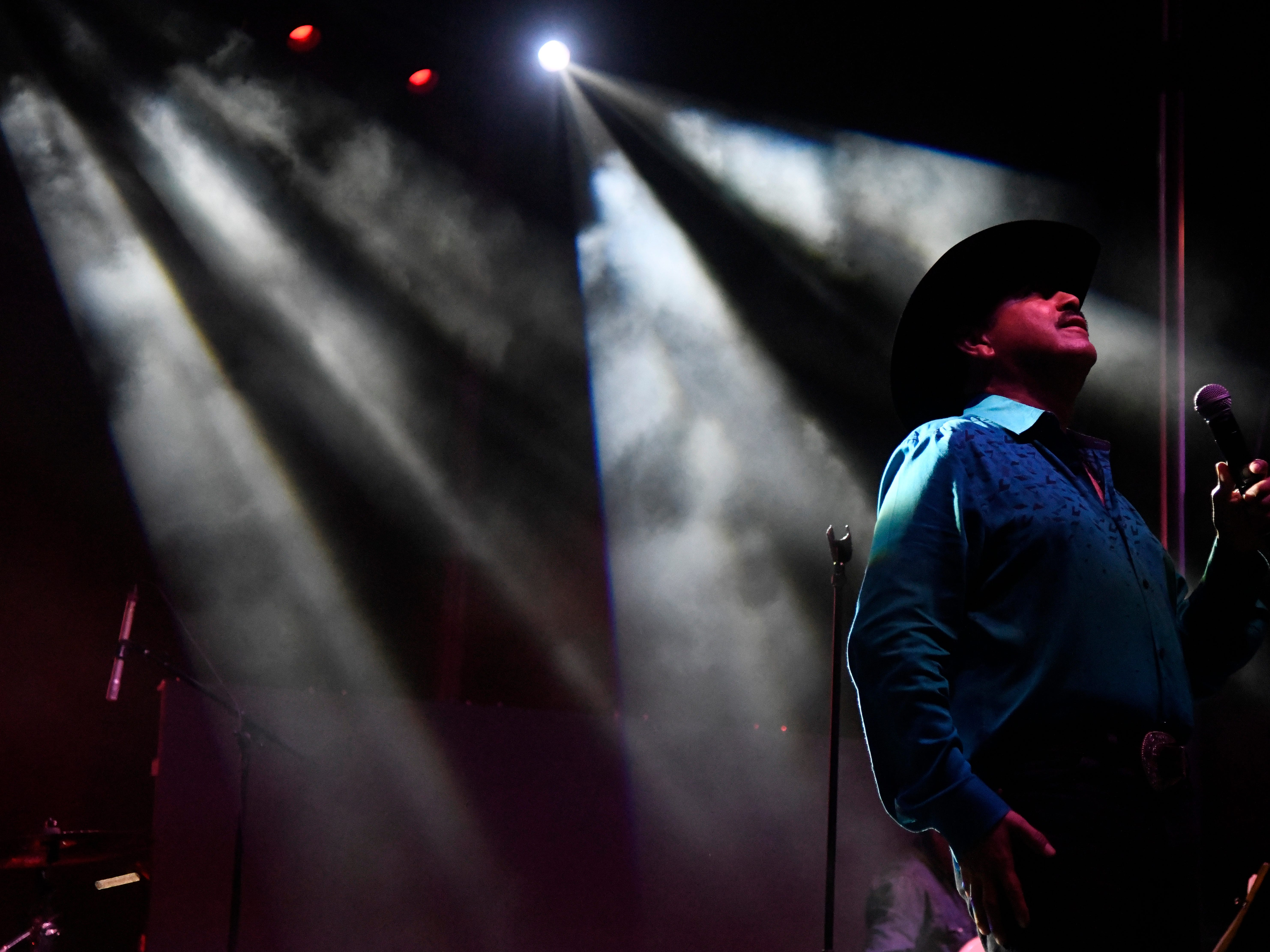 Gilbert Velasquez sings during his set of day one of Fiesta de la Flor, Friday, April 12, 2019, at American Bank Center.