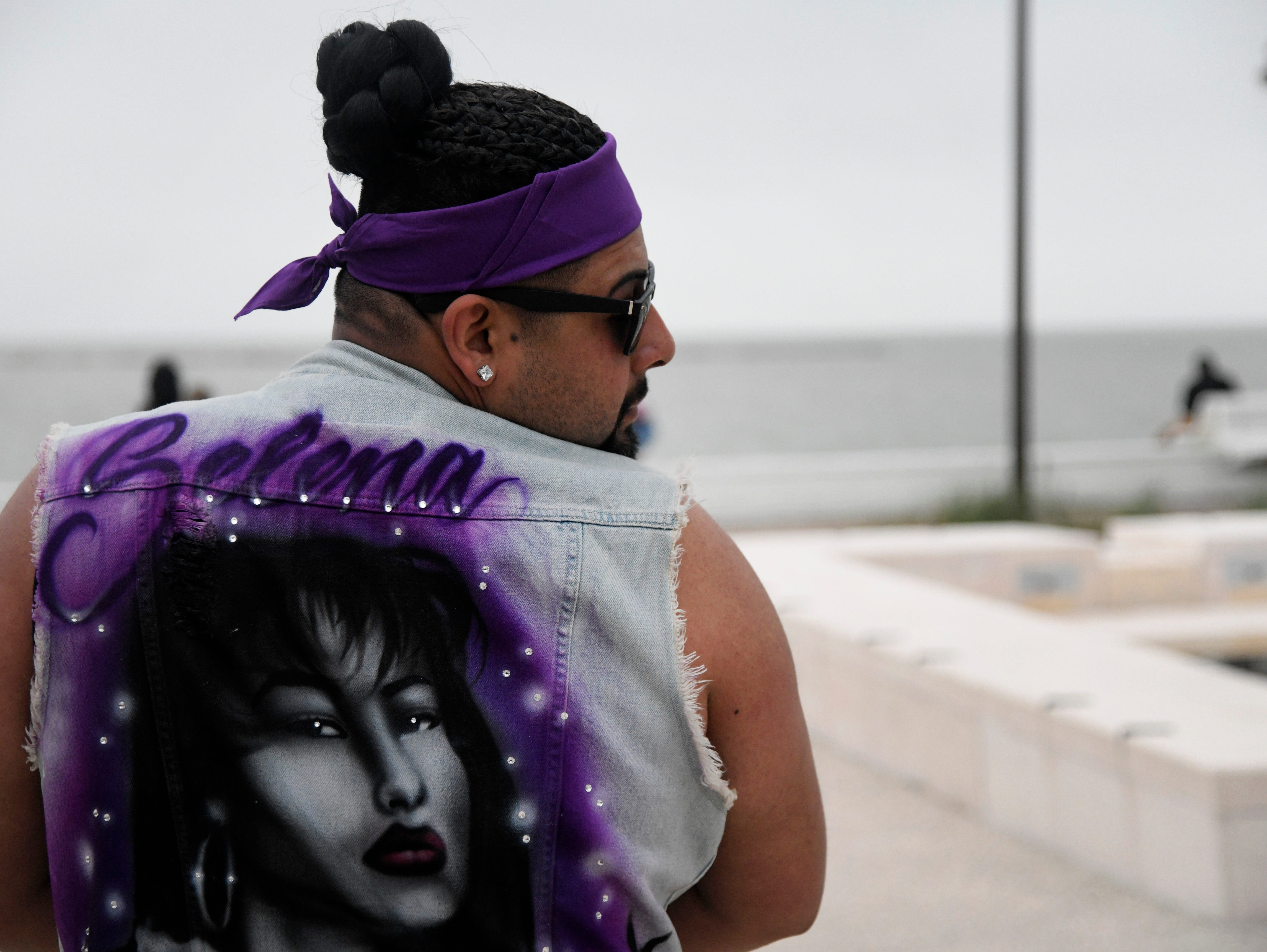 Pedro Morales poses with his denim Selena jacket during the first day of Fiesta de la Flor, Friday, April 12, 2019, at American Bank Center.