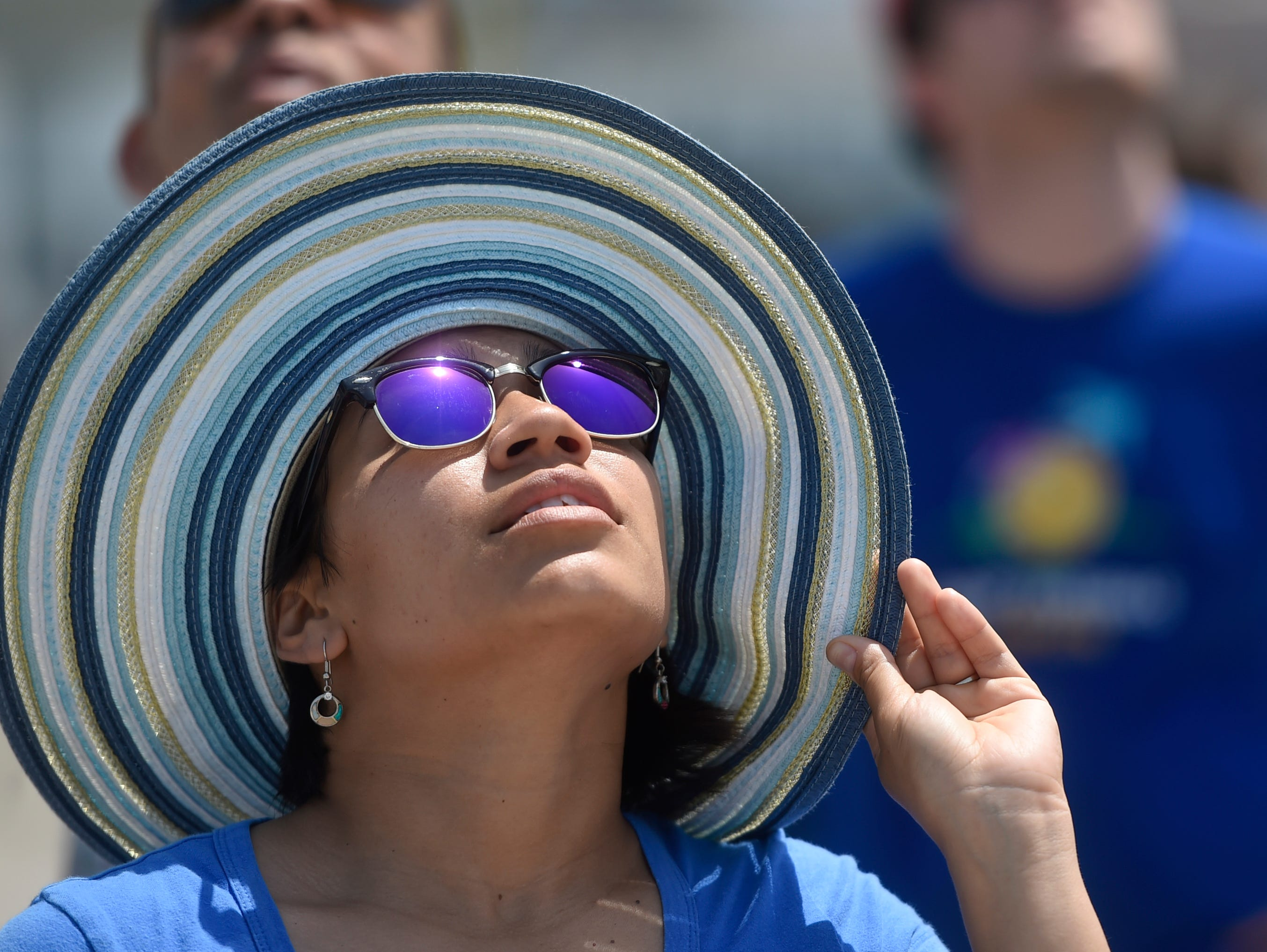 Lupita Tate looks at the performance during the Wings Over South Texas Air Show, Saturday, April 13, 2019, at NAS Corpus Christi. Tate has been stationed on the base for the past three years.