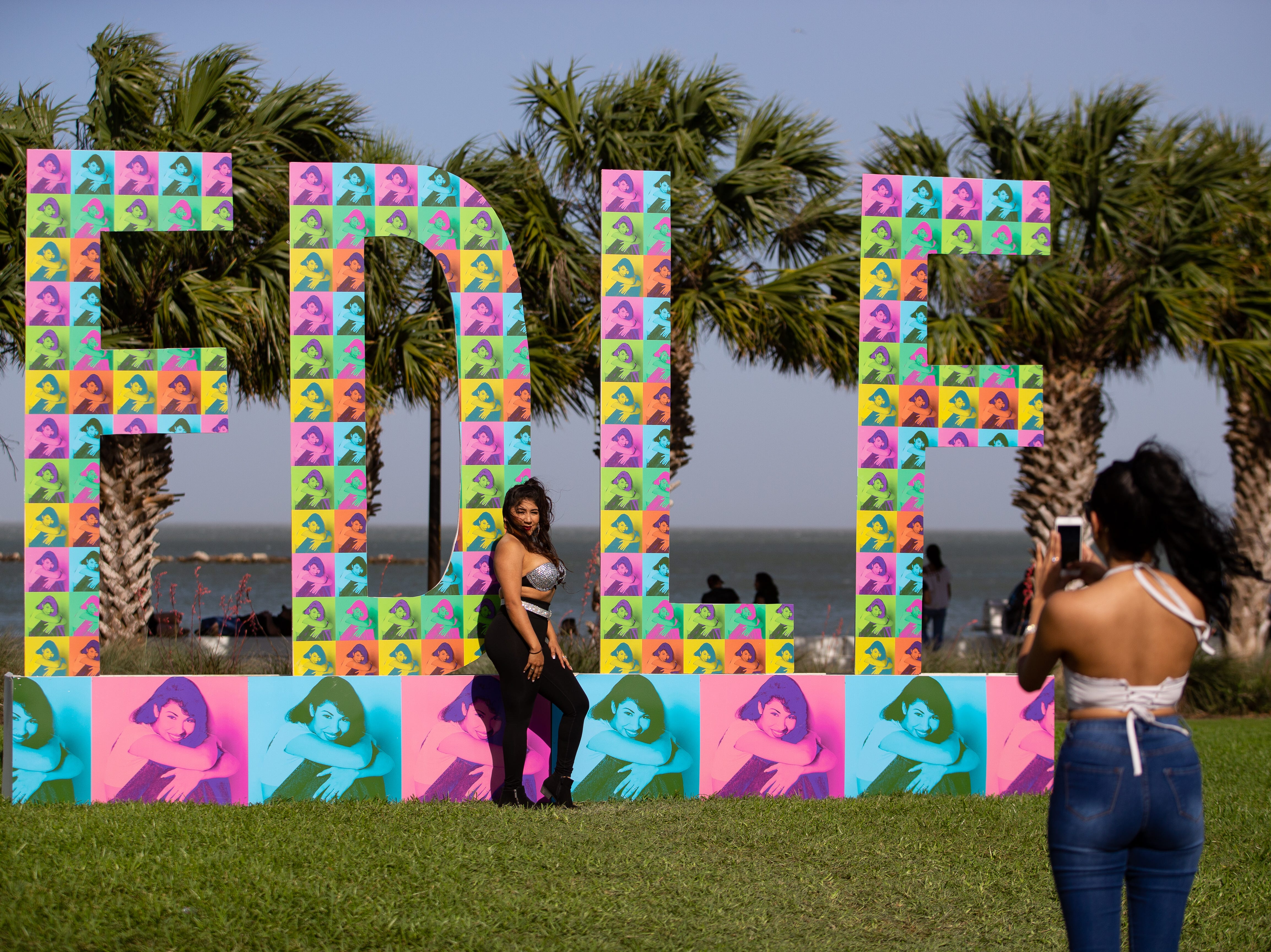 A women dressed as Selena has her photo taken during the second say of Fiesta de la Flor on Saturday, April 13, 2019.