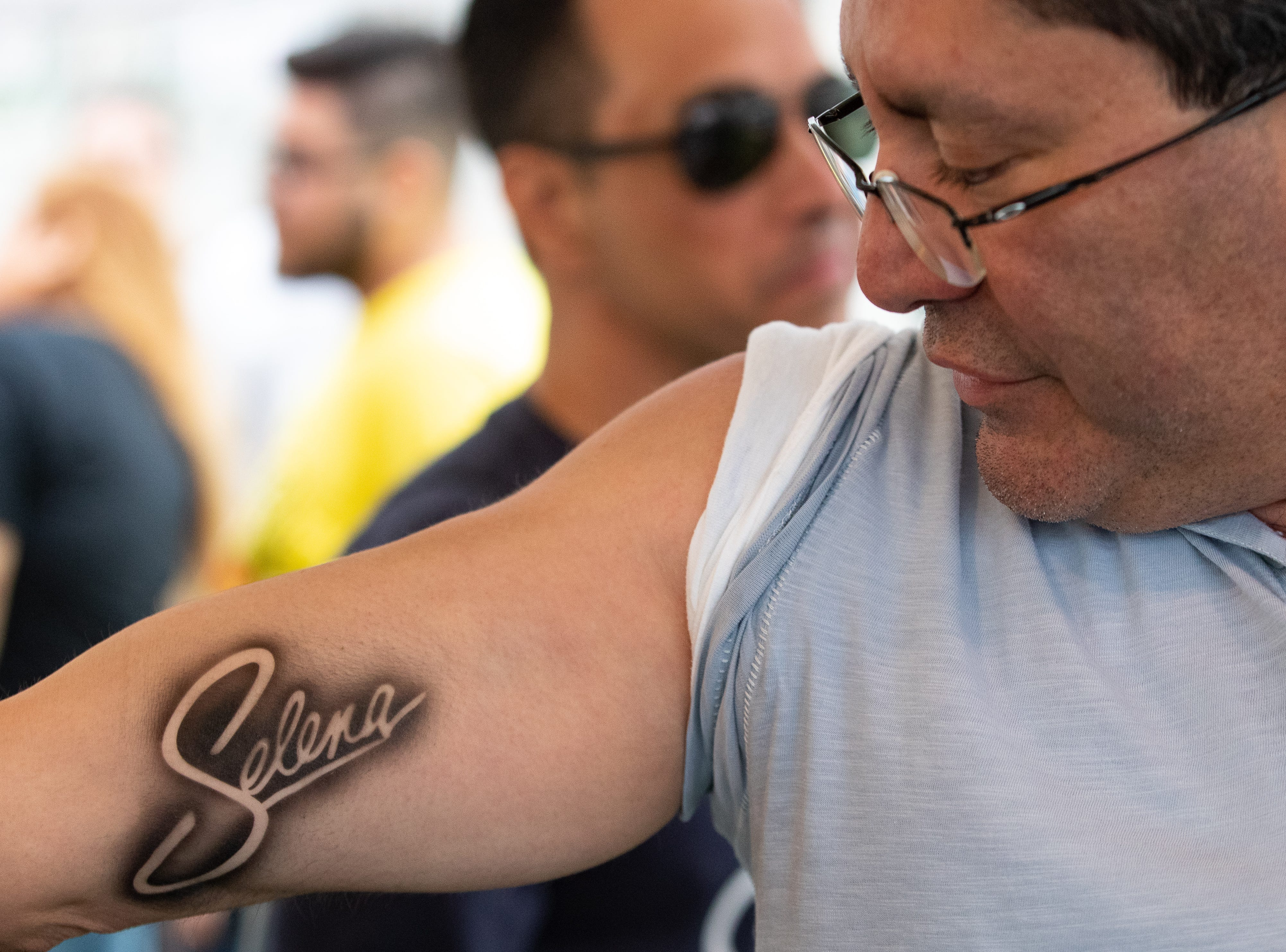 Eric Venegas of Midland, Texas has Selena's name air brushed on to his arm during the first day of Fiesta de la Flor on Friday, April 12, 2019.