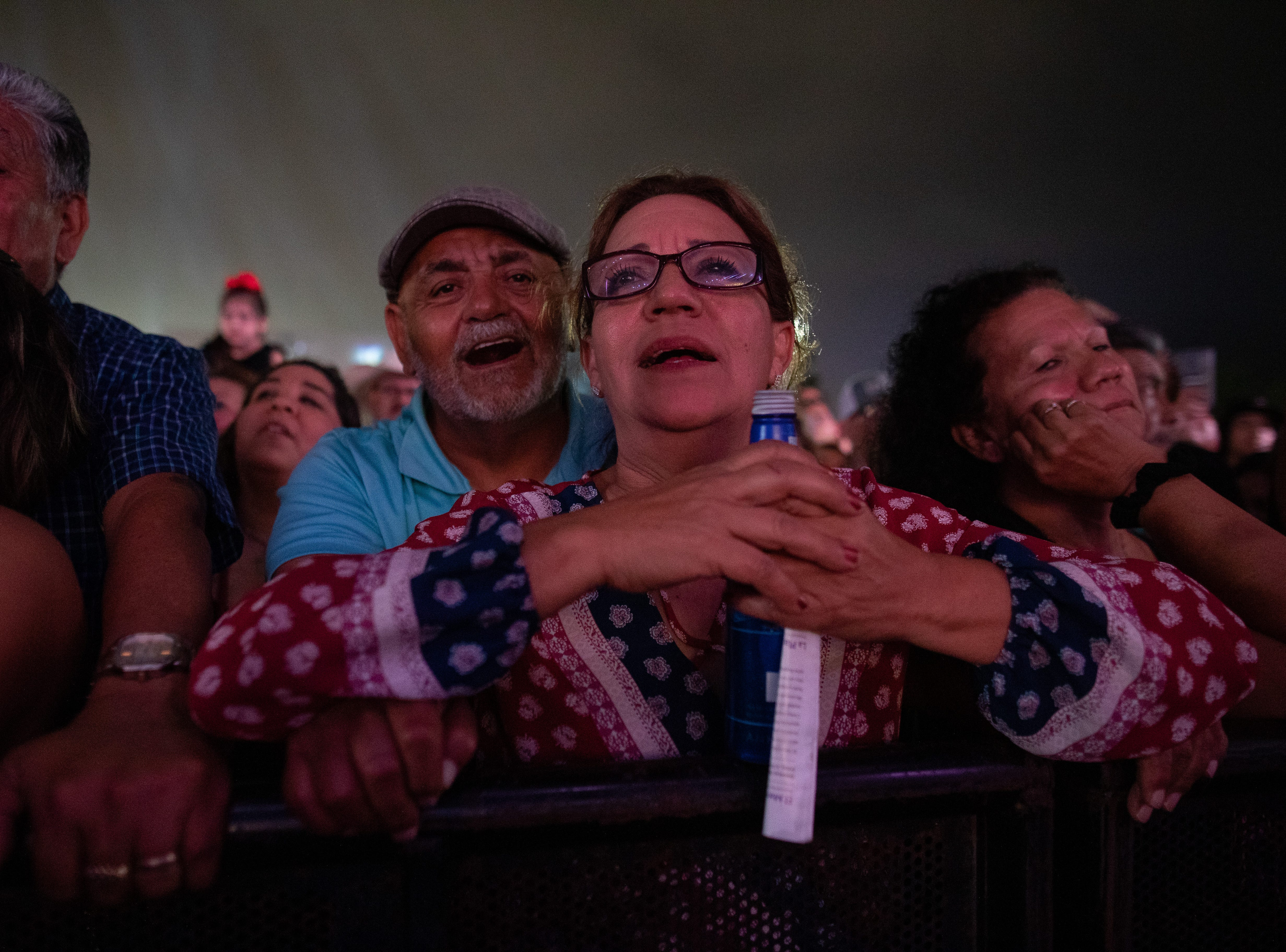 Fans watch as Little Joe Y LA Familia performs during the first day of Fiesta de la Flor on Friday, April 12, 2019.