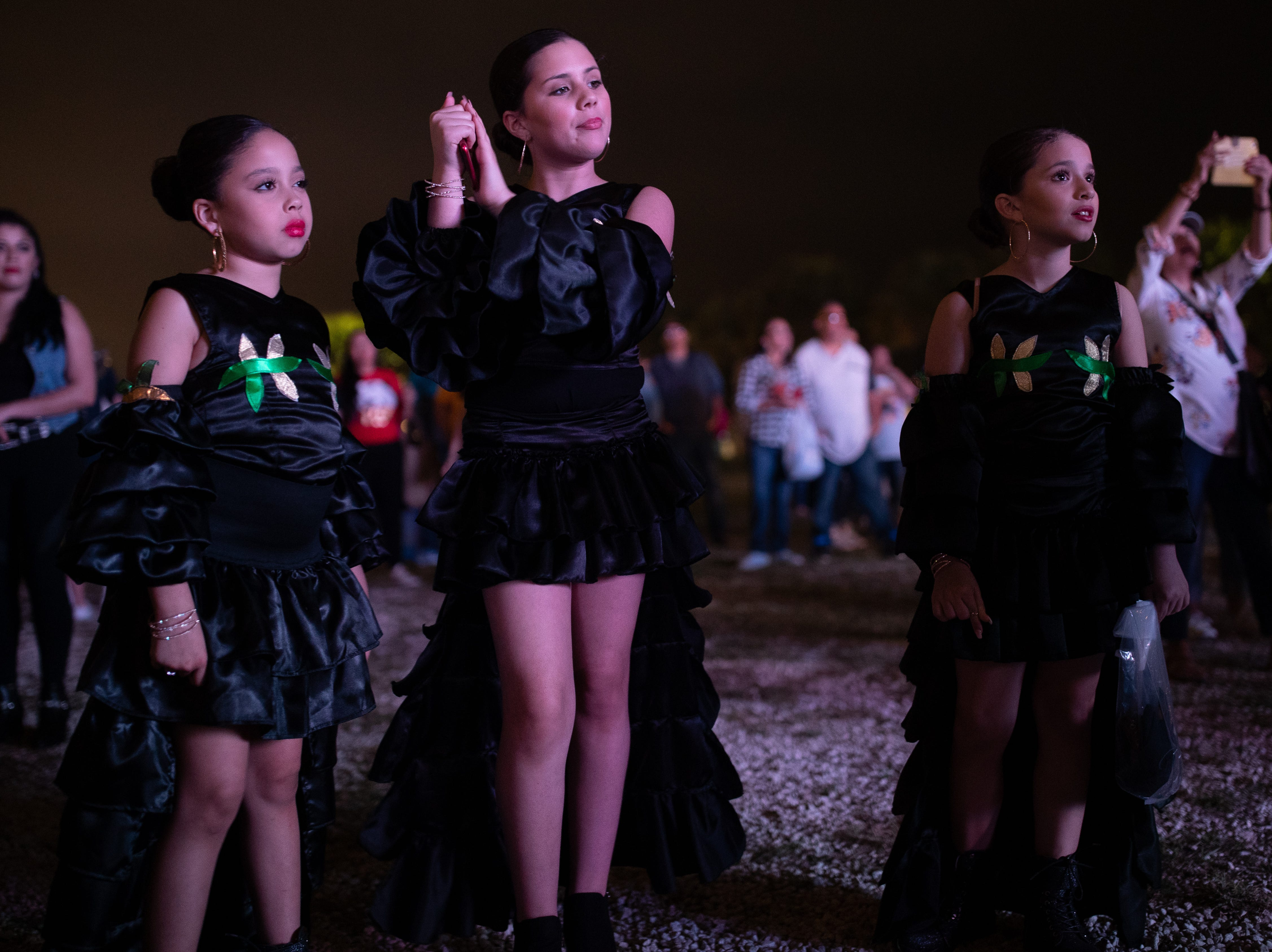 Jadasa Avalos, Jaylnn Avalos and Jahella Avalos of Maryland dance during Gilbert Velasquez and Friends set at the first day of Fiesta de la Flor on Friday, April 12, 2019.