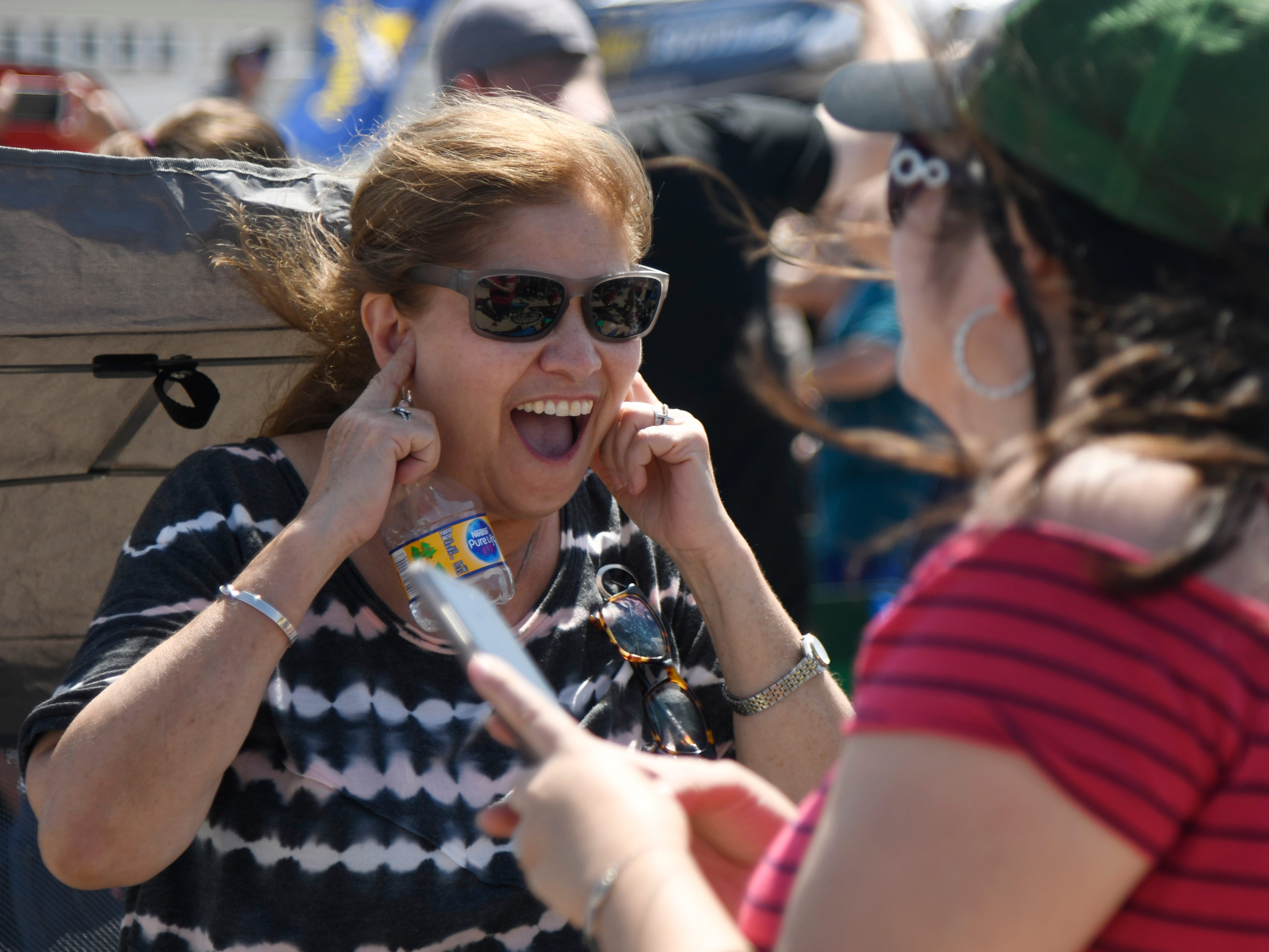 Mary Seenz reacts and plugs her ears while the Blue Angels perform during the Wings Over South Texas Air Show, Saturday, April 13, 2019, at NAS Corpus Christi. Seenz, whose husband is retired from the Navy, came from Rio Grande City to watch the show.