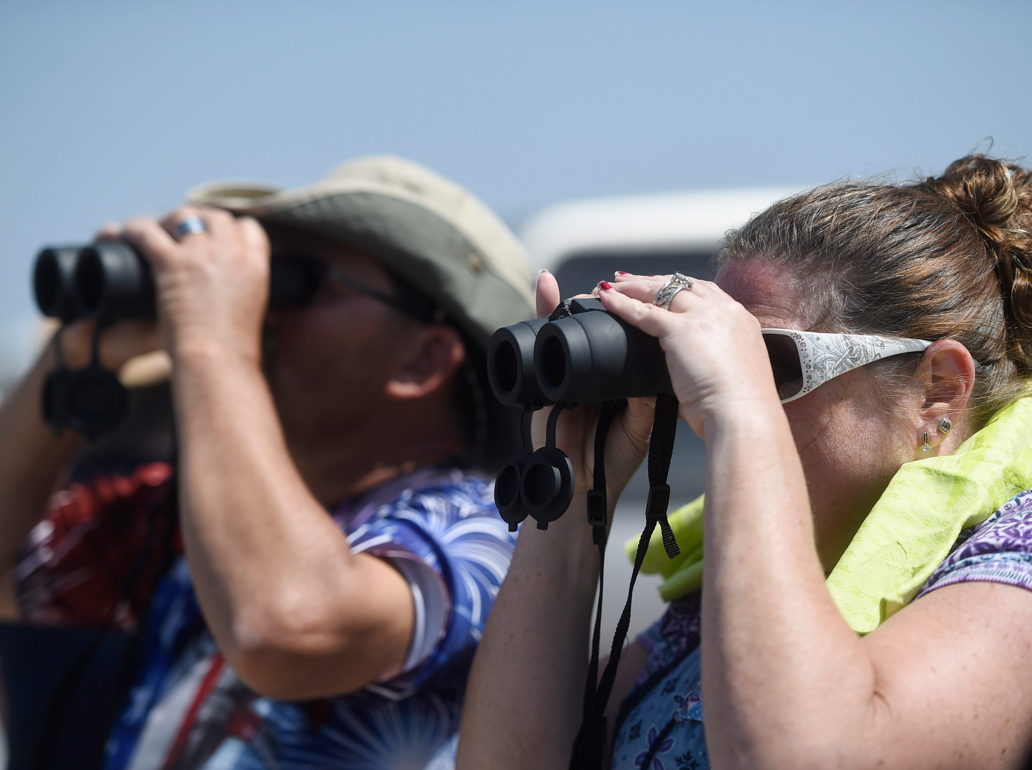 Attendees use binoculars to view the Wings Over South Texas Air Show, Saturday, April 13, 2019, at NAS Corpus Christi.
