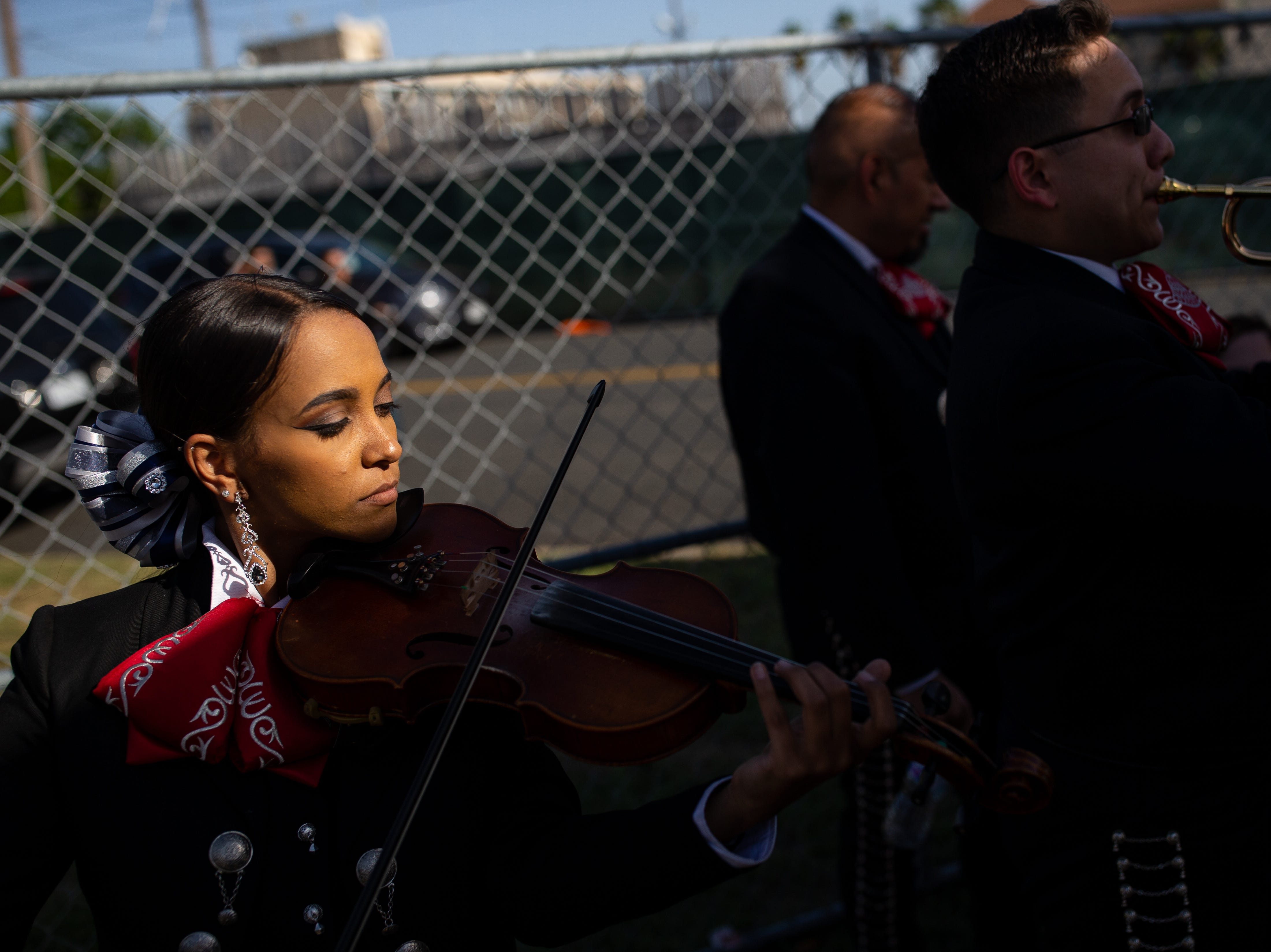 A member of the Mariachi Campanas De America warms up side stage during the second say of Fiesta de la Flor on Saturday, April 13, 2019.