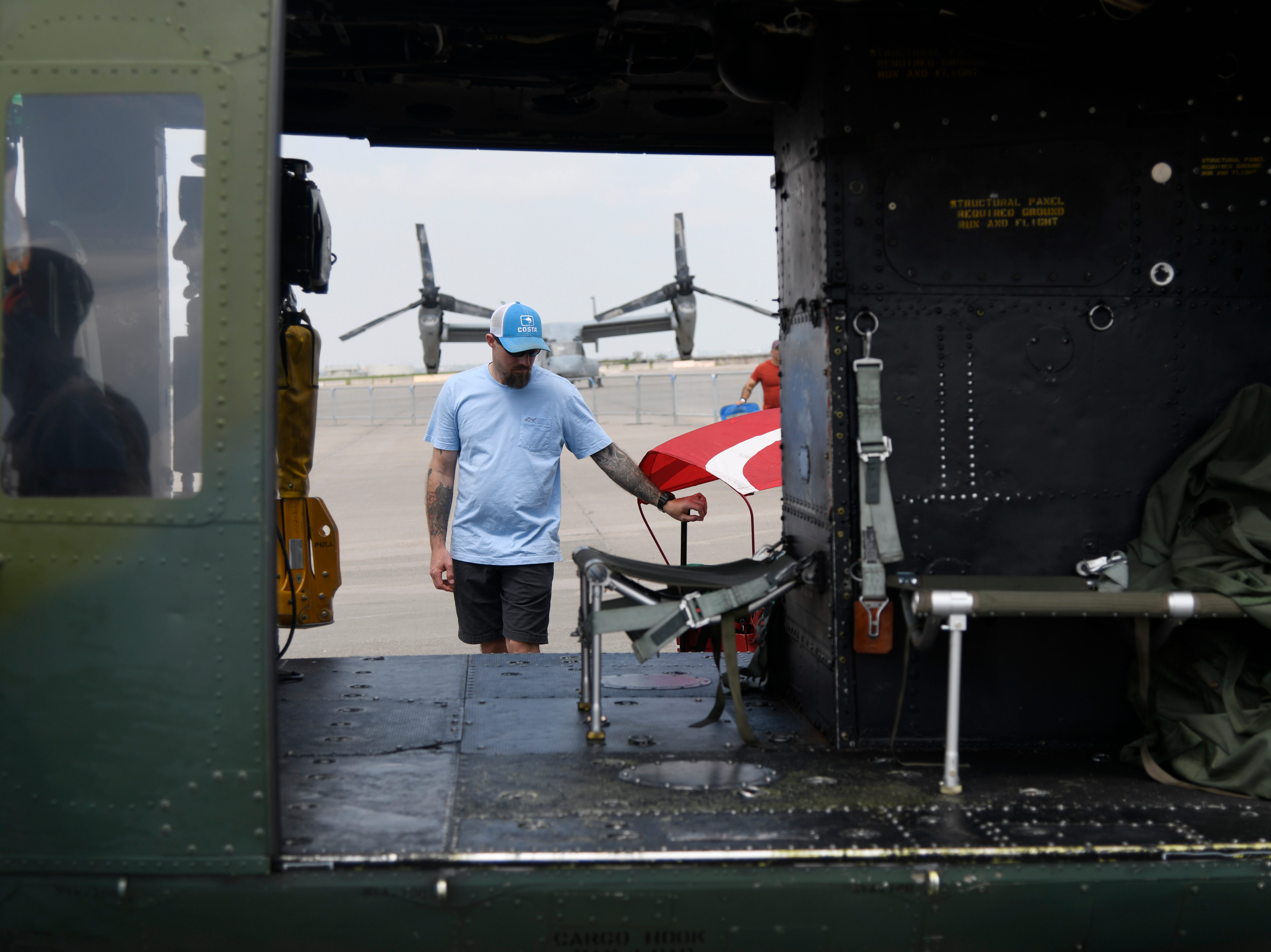An attendee looks at the inside of a helicopter before the Wings Over South Texas Air Show, Saturday, April 13, 2019, at NAS Corpus Christi.