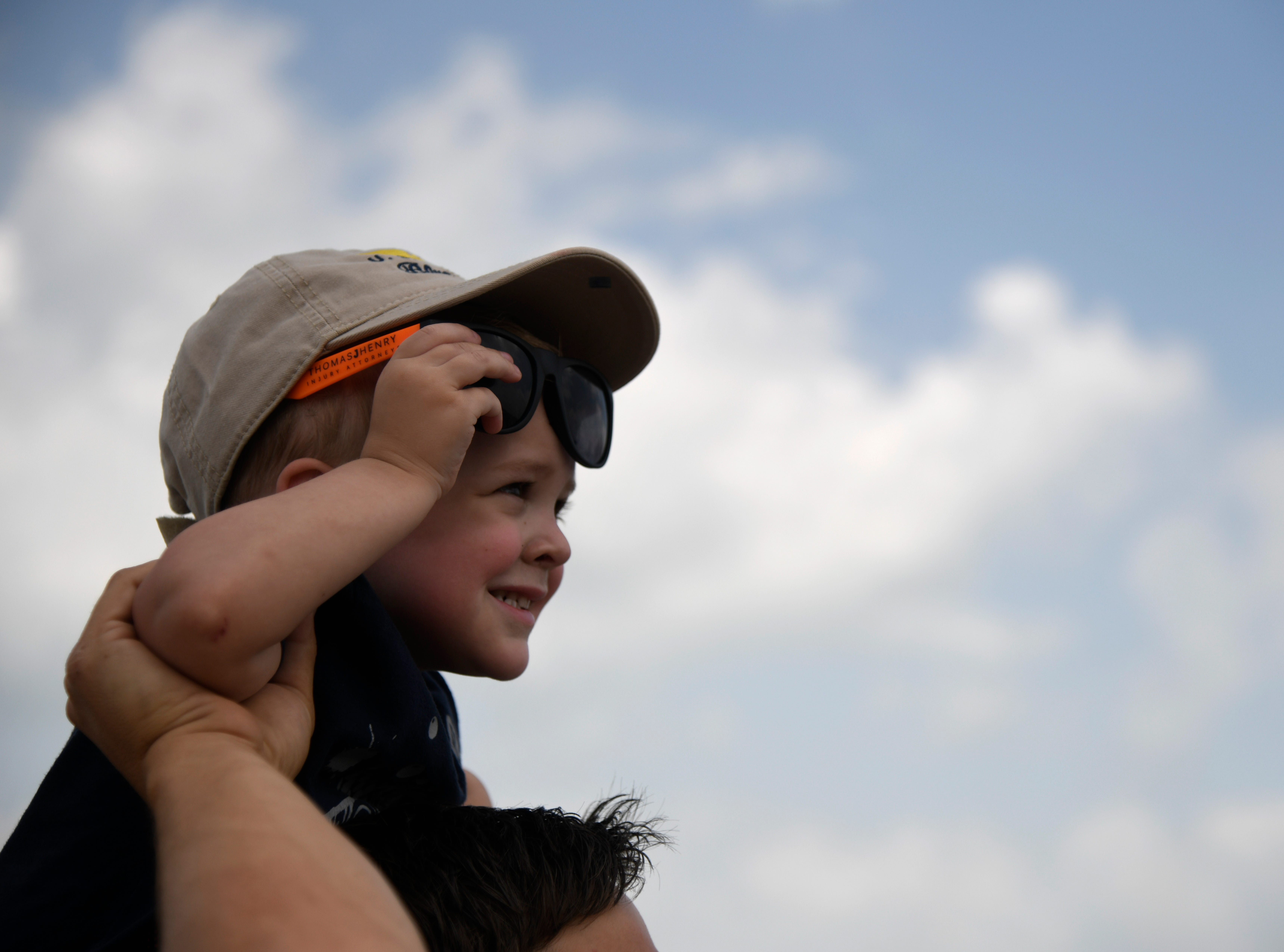 Two-year-old William Corey sits on his dad's shoulders during the Wings Over South Texas Air Show, Saturday, April 13, 2019, at NAS Corpus Christi. This is Corey's first air show and he says he is excited to see the Blue Angels.