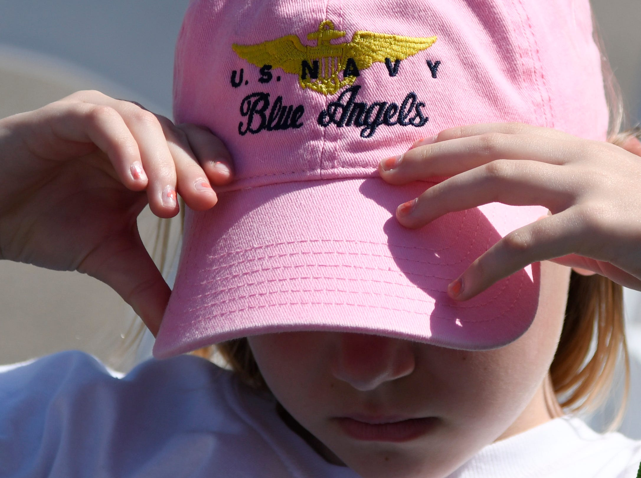 A child adjusts her Blue Angels hat during the Wings Over South Texas Air Show, Saturday, April 13, 2019, at NAS Corpus Christi.