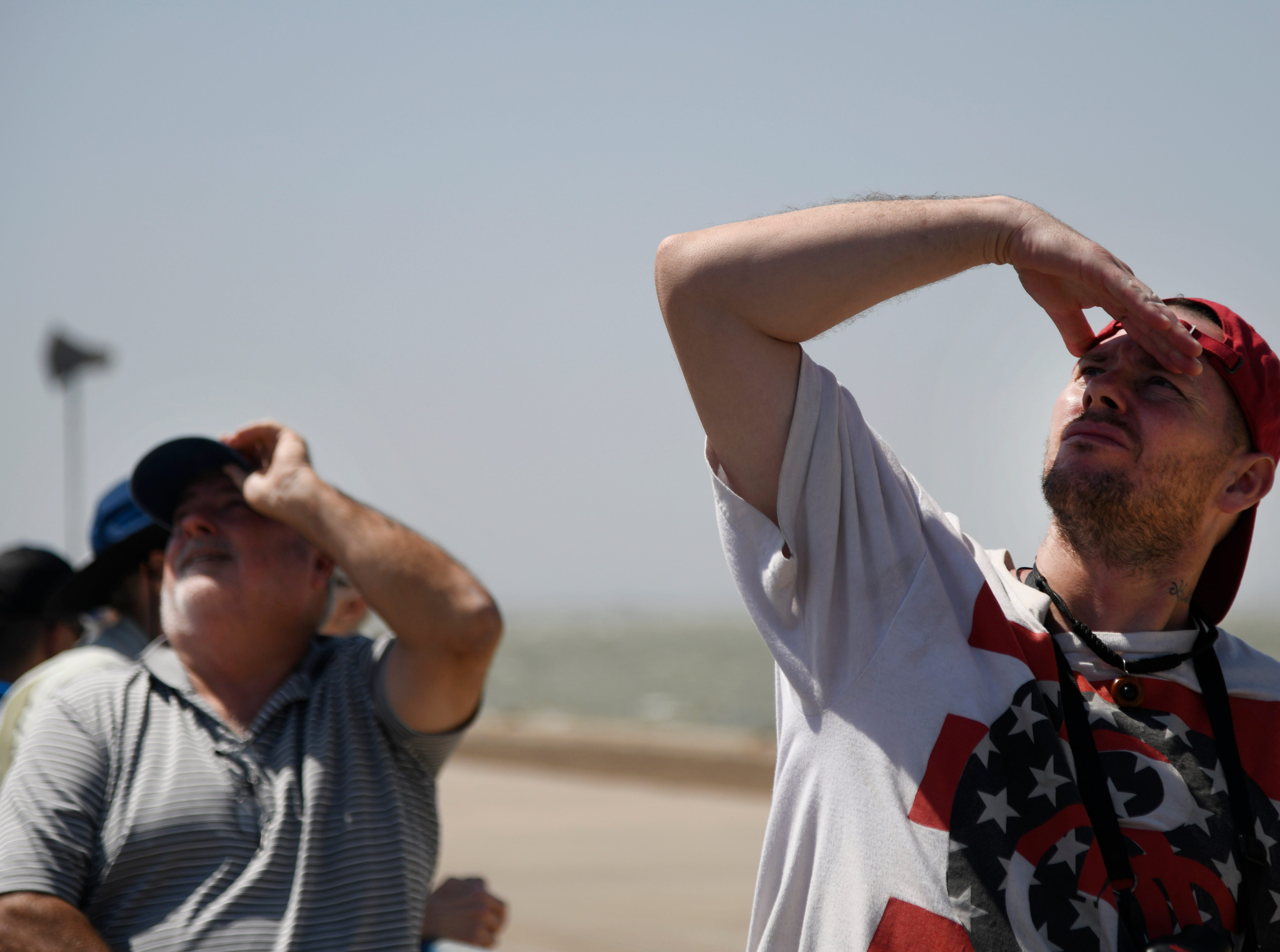 Spectators look for the Blue Angels' planes during the Wings Over South Texas Air Show, Saturday, April 13, 2019, at NAS Corpus Christi.