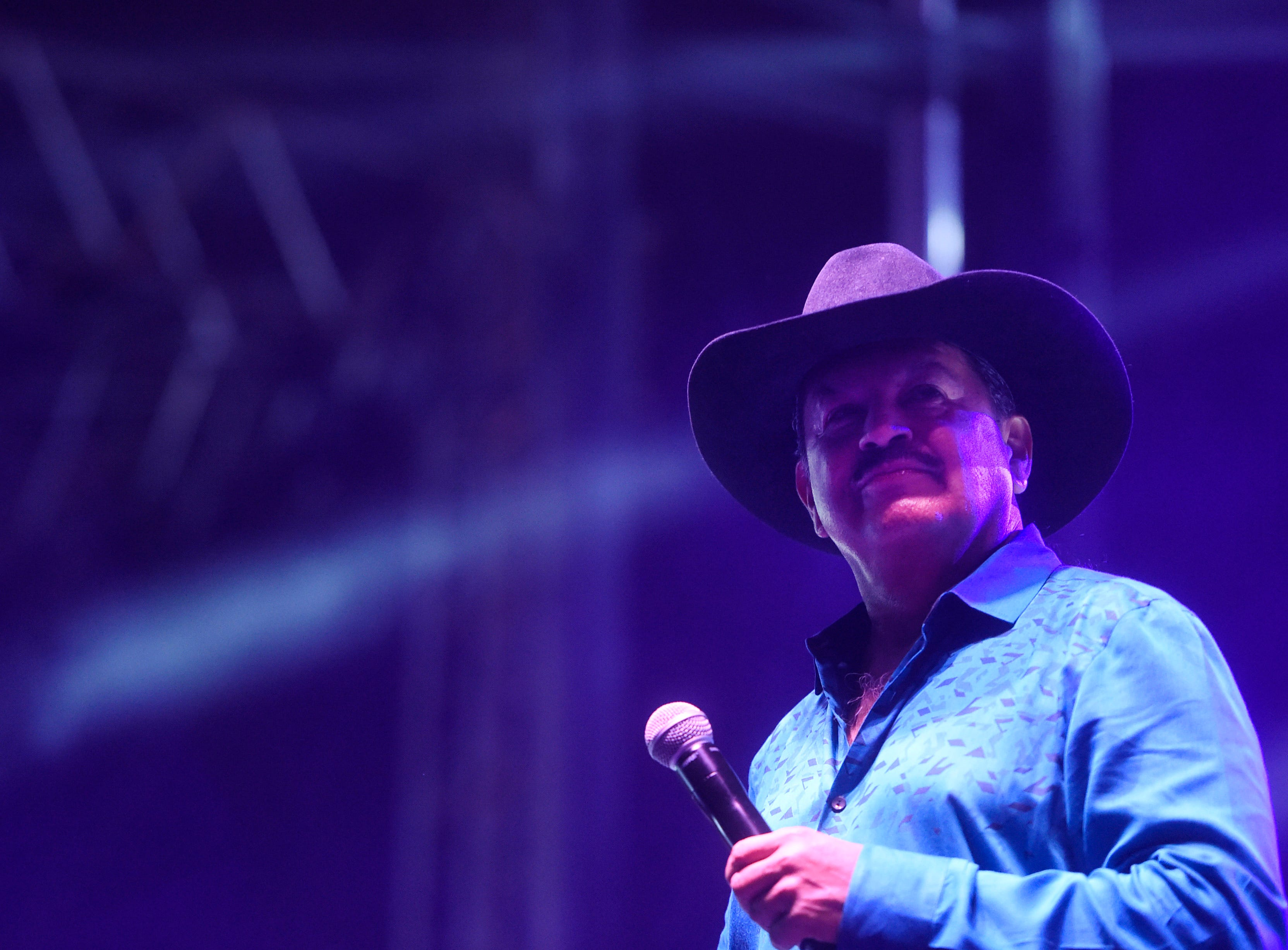 Gilbert Velasquez pause on stage during his set at the first day of Fiesta de la Flor, Friday, April 12, 2019, at American Bank Center.