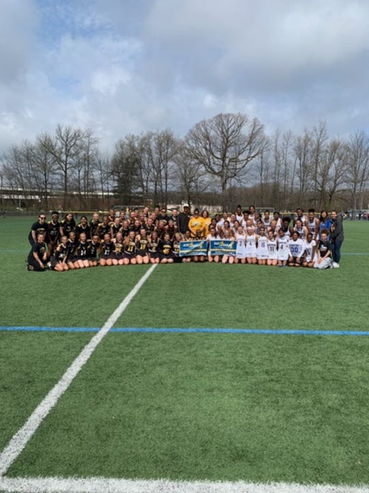 The North Brunswick and South Brunswick girls lacrosse teams combined to raise more than $5,000 for Go4theGoal's Lace Up 4 Pediatric Cancer campaign