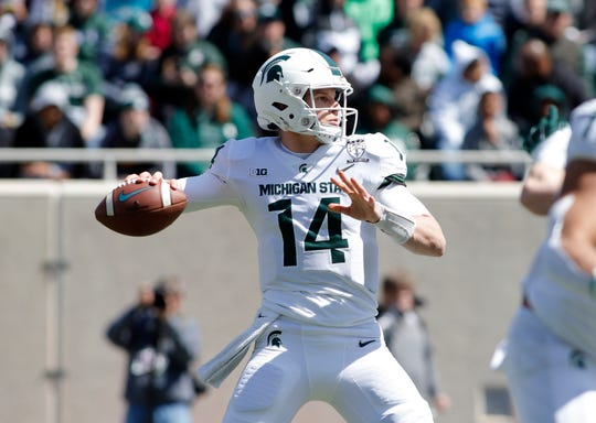 Michigan State quarterback Brian Lewerke looks to throw a pass during a spring scrimmage Saturday, April 13, 2019, in East Lansing.