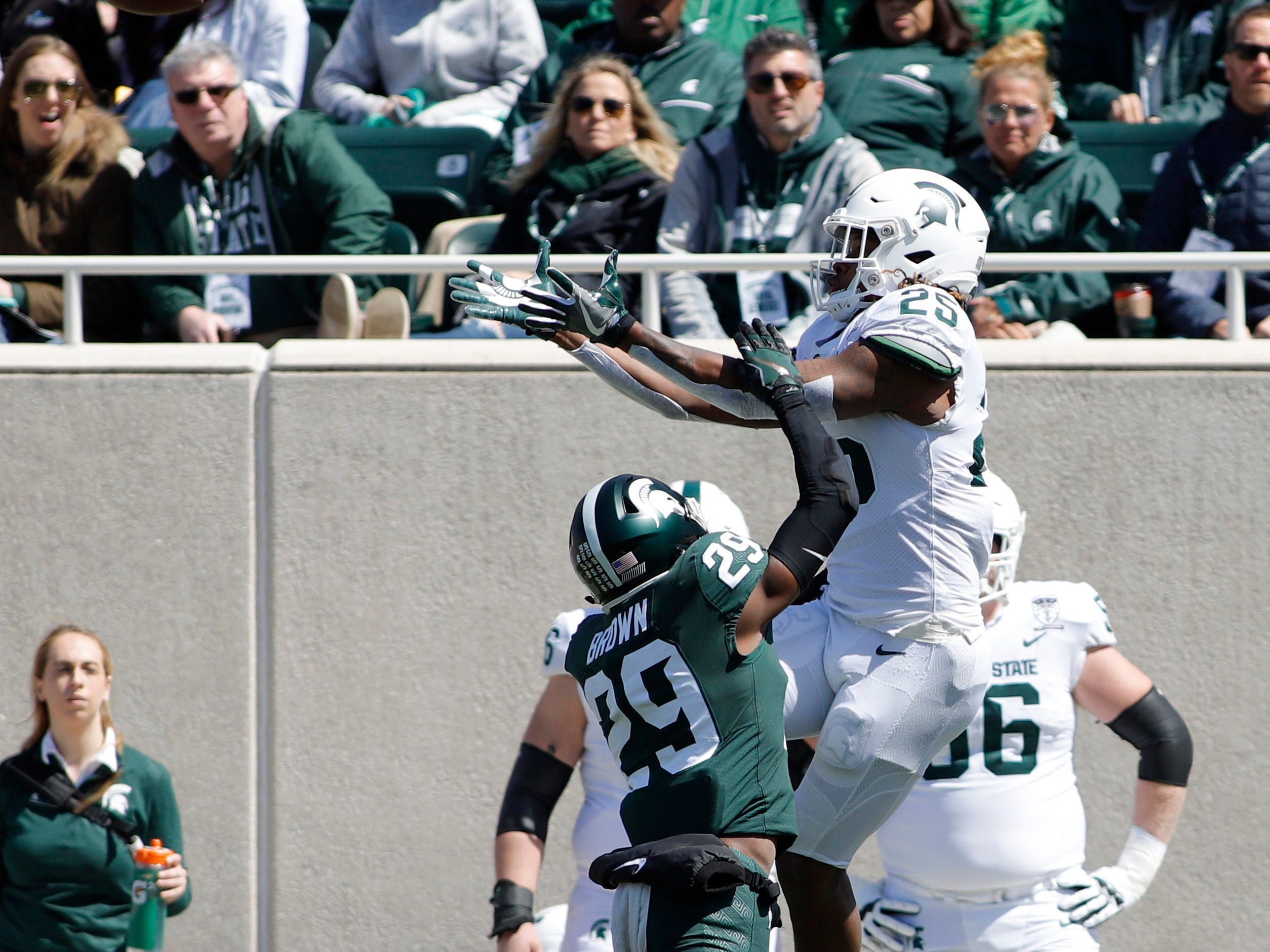 Michigan State's Darrell Stewart Jr., right, catches a pass over Shakur Brown (29) during a spring scrimmage Saturday, April 13, 2019, in East Lansing.