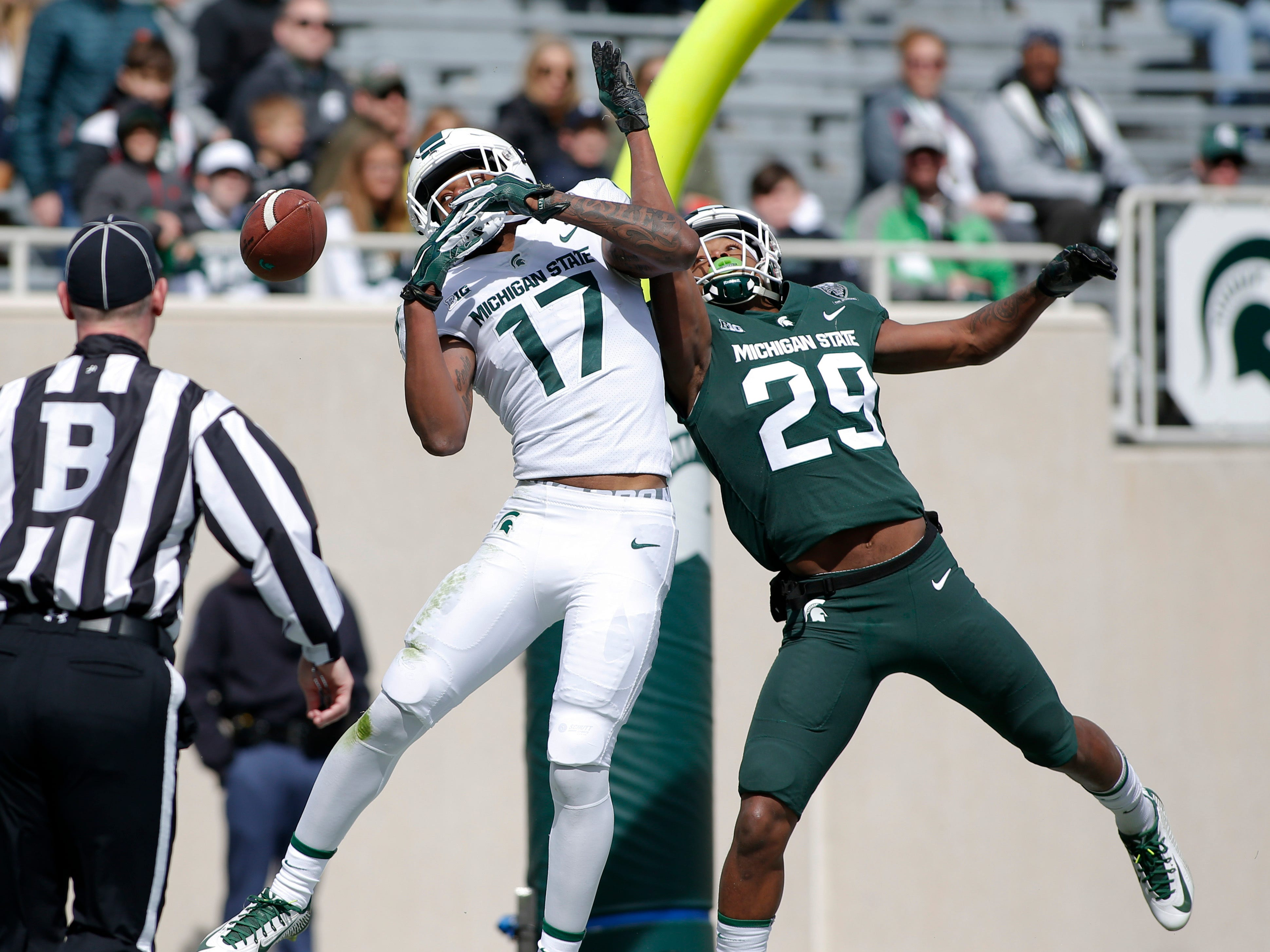 Michigan State's Shakur Brown, right, breaks up a pass intended for Tre Mosley during a spring scrimmage Saturday, April 13, 2019, in East Lansing.