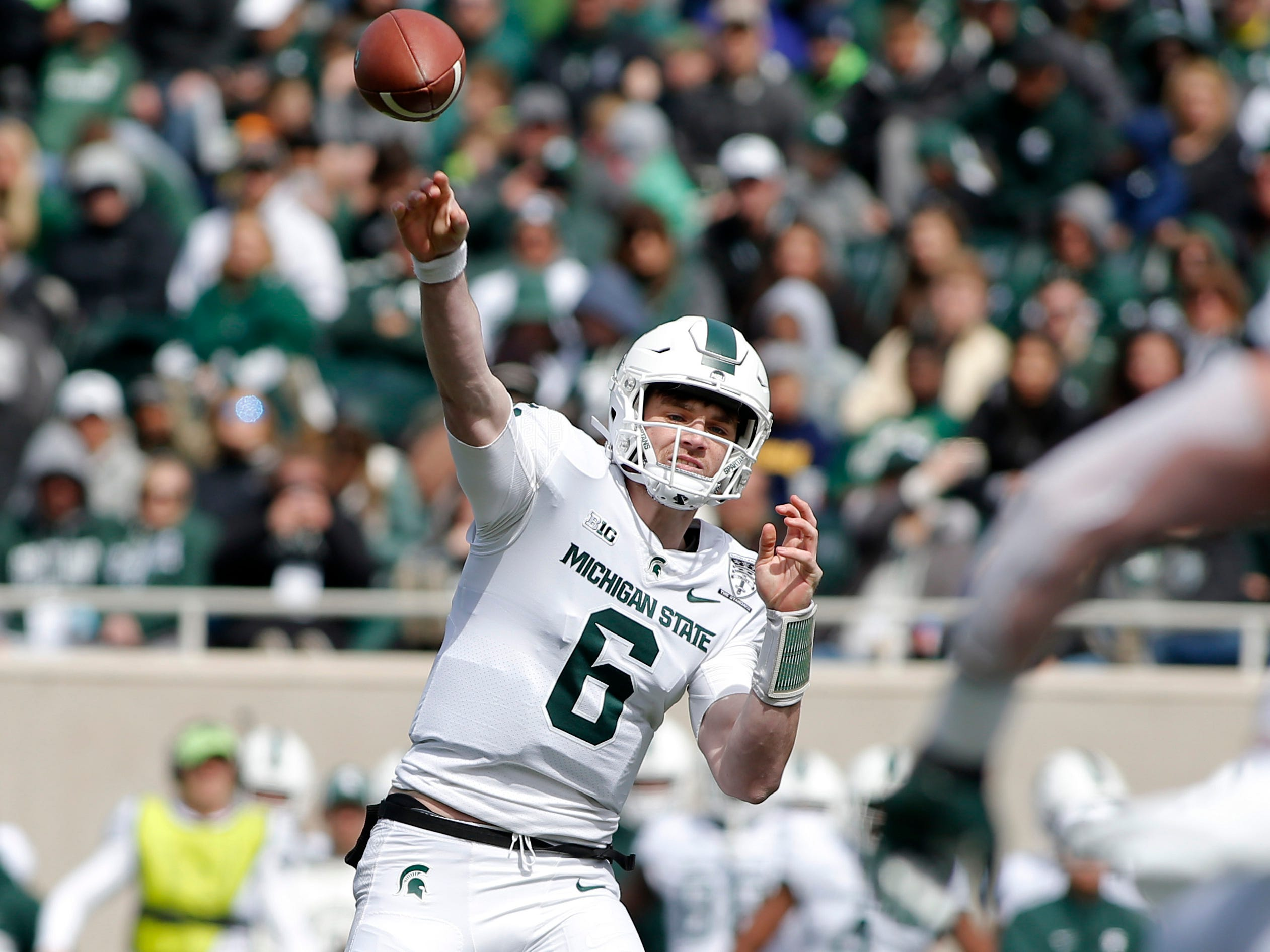Michigan State quarterback Theo Day throws during a spring scrimmage Saturday, April 13, 2019, in East Lansing.