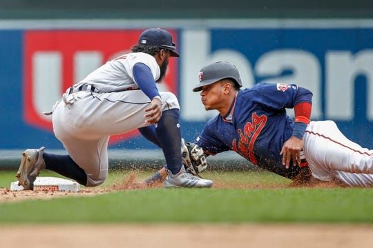 Tigers second baseman Josh Harrison tags out Twins shortstop Jorge Polanco on a stolen base attempt in the fifth inning at Target Field.