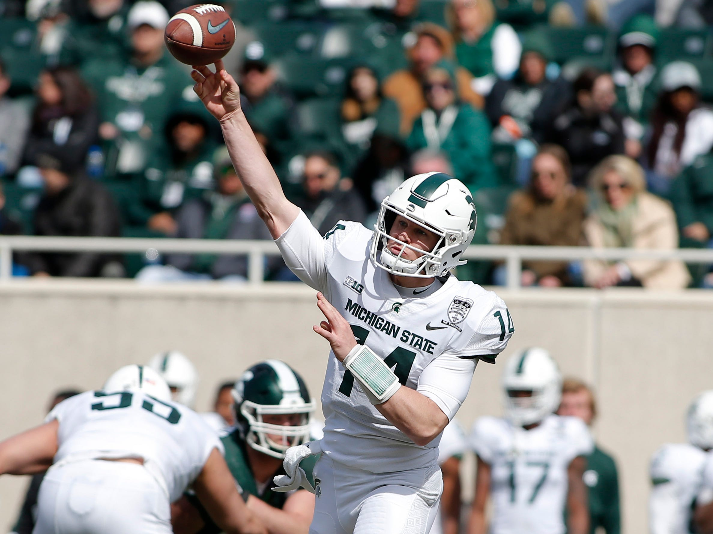 Michigan State quarterback Brian Lewerke throws a pass during a spring scrimmage game, Saturday, April 13, 2019, in East Lansing.