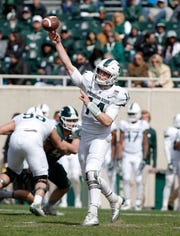 Michigan State quarterback Brian Lewerke throws a pass during a spring scrimmage game Saturday, in East Lansing.