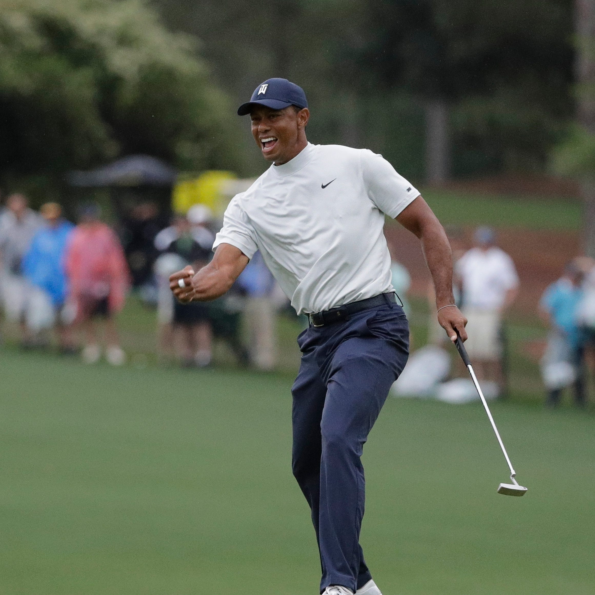 Tiger's late charge creates star-studded Masters logjam