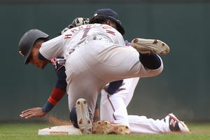 Minnesota Twins' Jorge Polanco is tagged out at second base by Detroit Tigers' Josh Harrison Saturday. The Twins won 4-3.