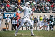 Quarterback Brian Lewerke (14) passes the ball during the third quarter of the annual Michigan State Green-White spring football game Saturday
