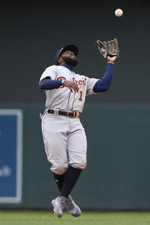 Detroit Tigers' Josh Harrison catches the ball during a game against the Minnesota Twins. The Twins won 4-3.