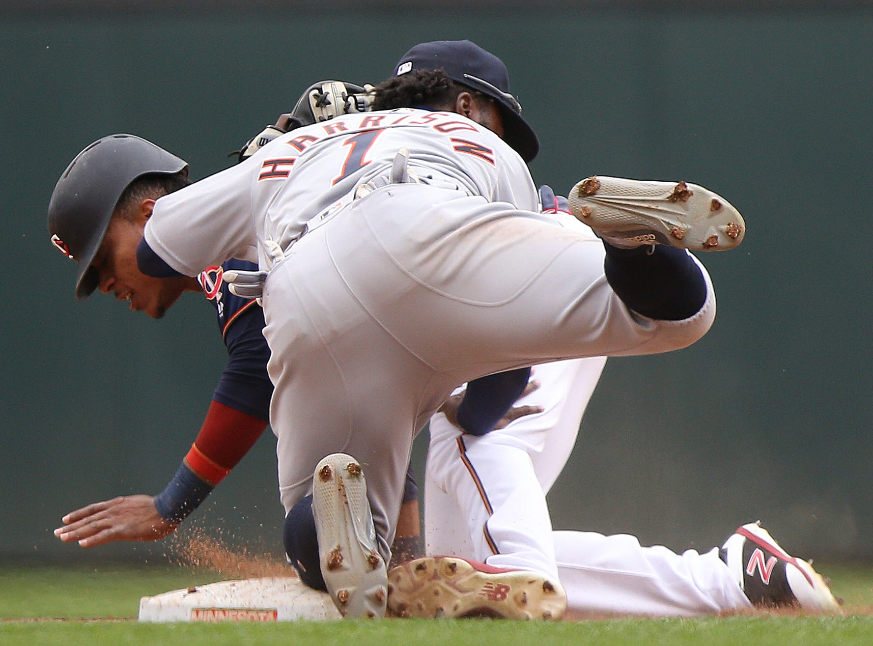 Minnesota Twins' Jorge Polanco is tagged out at second base by Detroit Tigers' Josh Harrison. The Twins won 4-3.