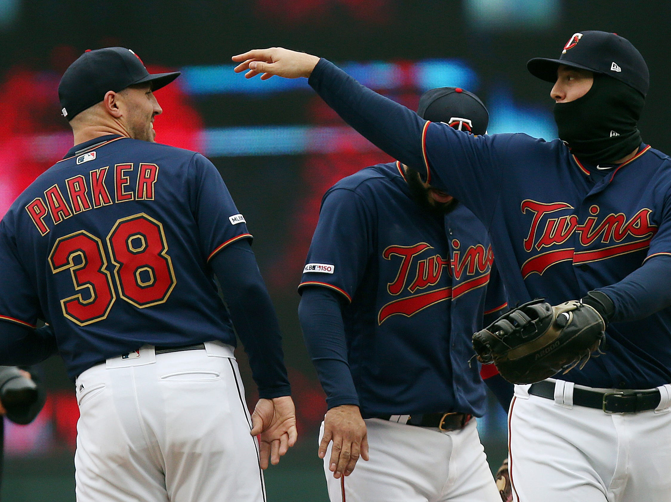 Minnesota Twins' pitcher Blake Parker smiles as teammate C.J. Cron congratulates him on after their 4-3 win against the Detroit Tigers Saturday, April 13, 2019 in Minneapolis.