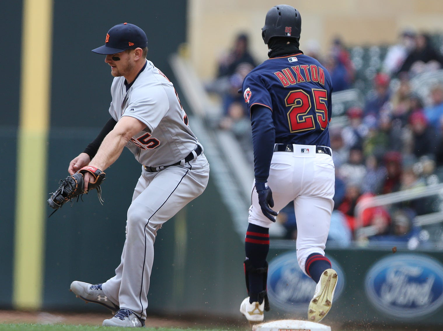 Detroit Tigers' John Hicks gets Minnesota Twins' Bryon Buxton out at first base. The Twins won 4-3.