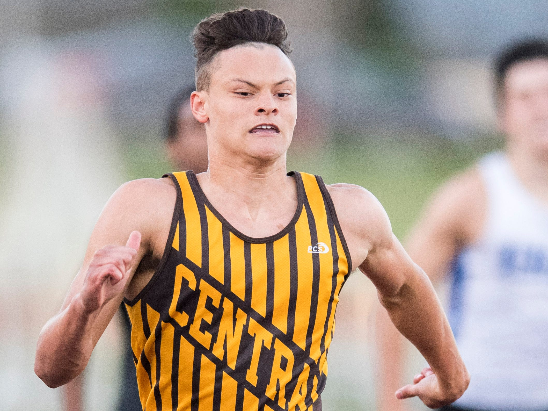 Jalen Bowman gains speed in the boys 200m dash  during the 2019 City Track and Field meet at Central High School Friday, April 12, 2019. Bowman placed first in the event.