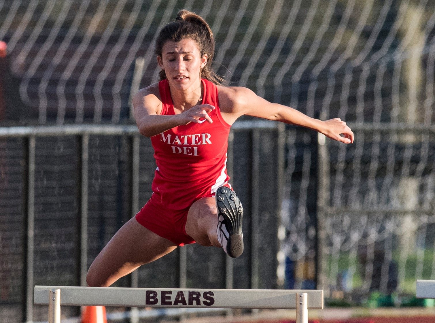 Mater Dei's Victoria Zigenfus clears a hurdle in the girls 300m low hurdle event during the 2019 City Track and Field meet at Central High School Friday, April 12, 2019.  Zingenfus won first place in the event at 47.27 seconds.