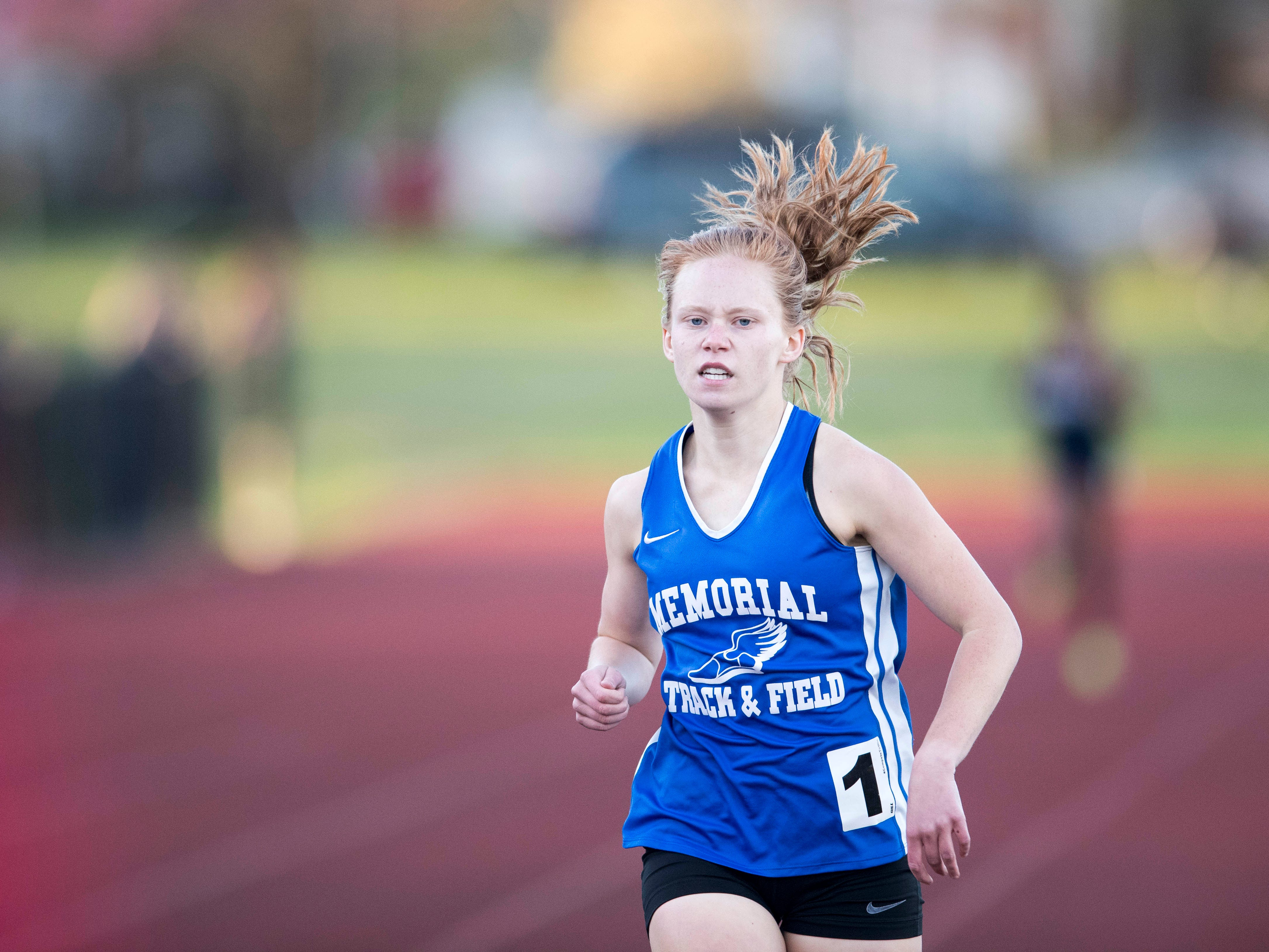 Memorial's Allison Morphew leads in the girls 800m run during the 2019 City Track and Field meet at Central High School Friday, April 12, 2019.