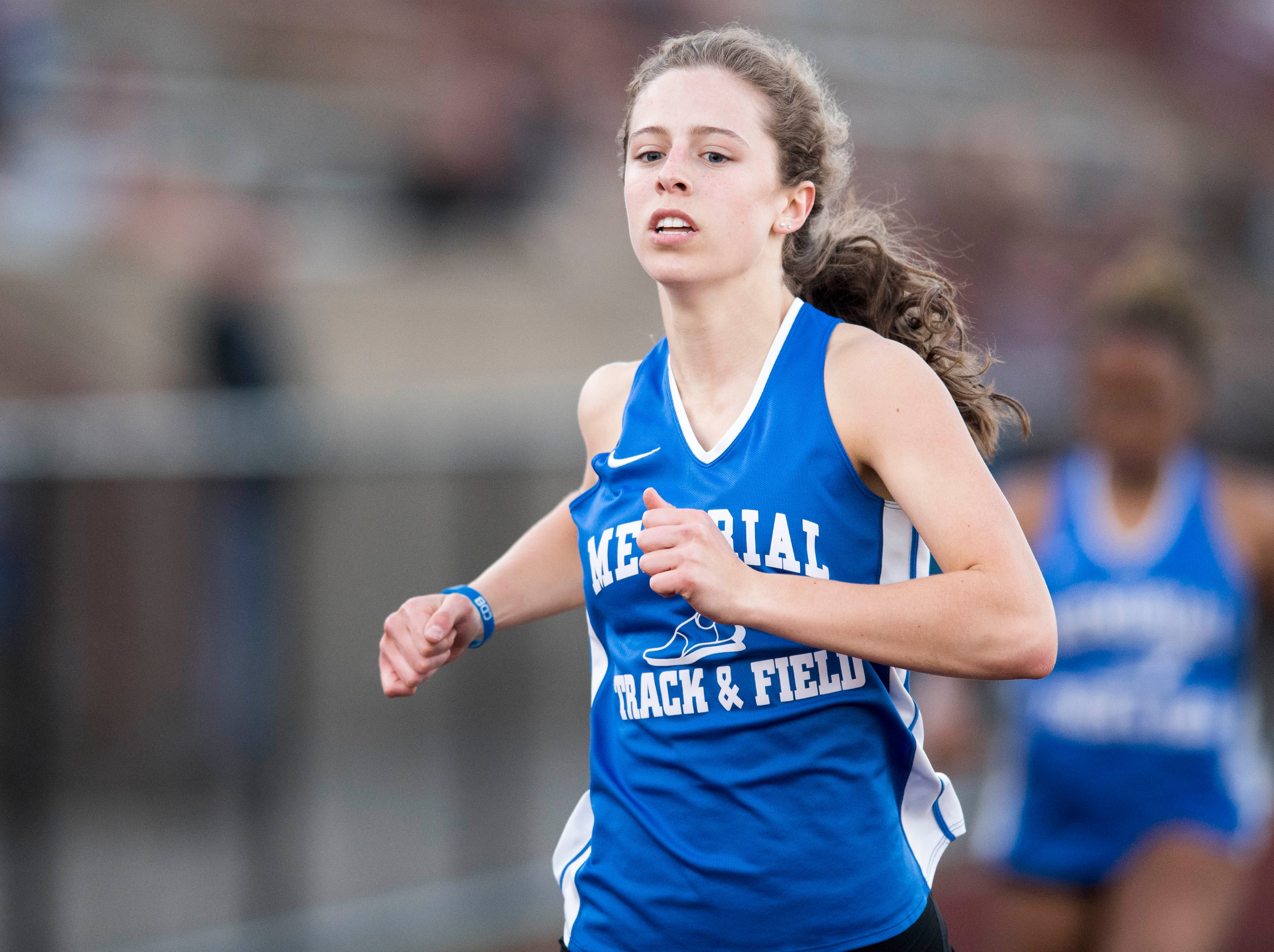 Memorial's Ellen Hayhurst crosses the finish line in the girls 200m dash during the 2019 City Track and Field meet at  Central High School Friday, April 12, 2019. Hayhurst placed first in the event.