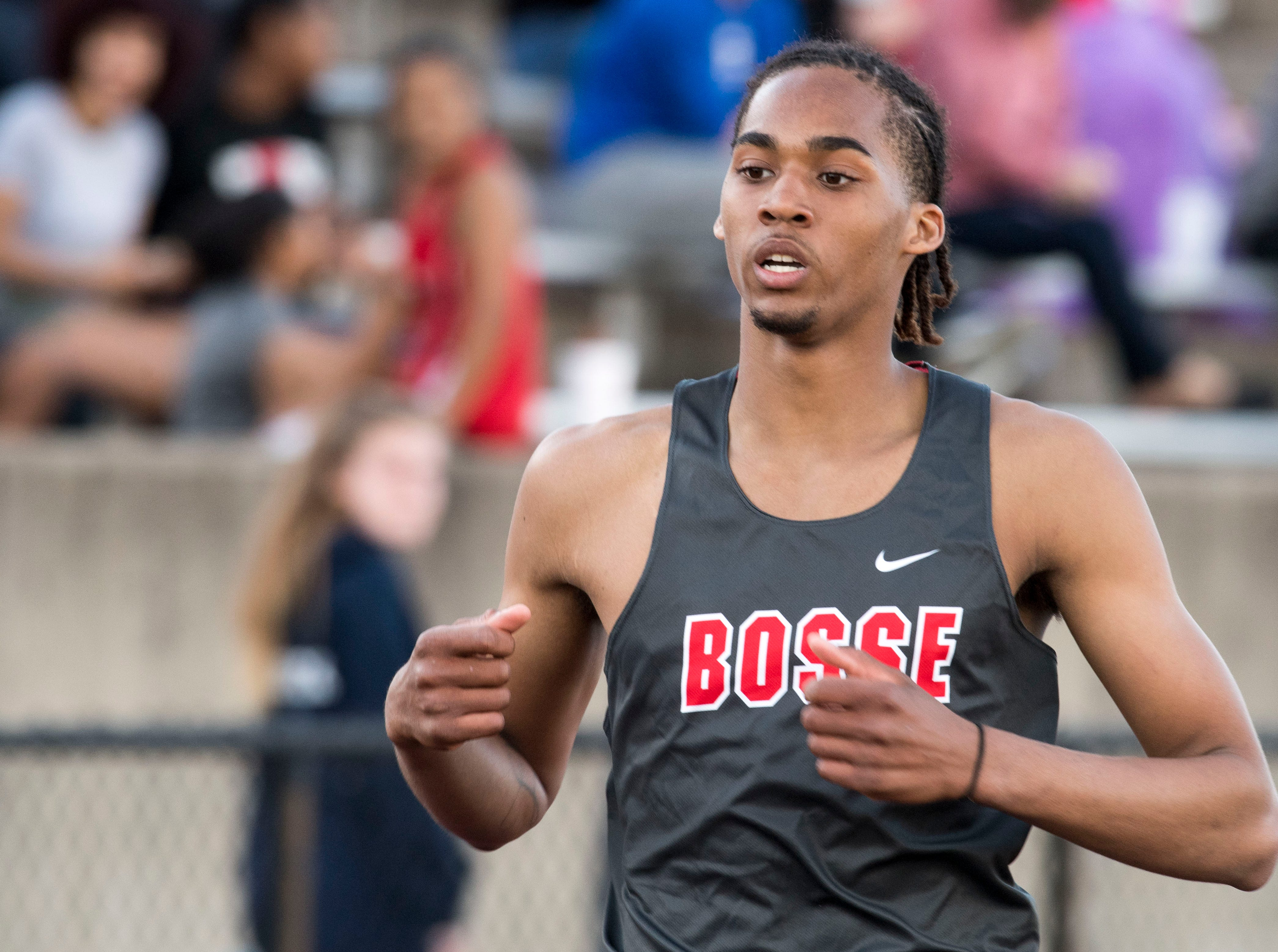 Bosse's George Madison crosses the finish line for the 400m dash event during the 2019 City Track and Field meet at Central High School Friday, April 12, 2019.  Madison places first at 51.05 seconds.