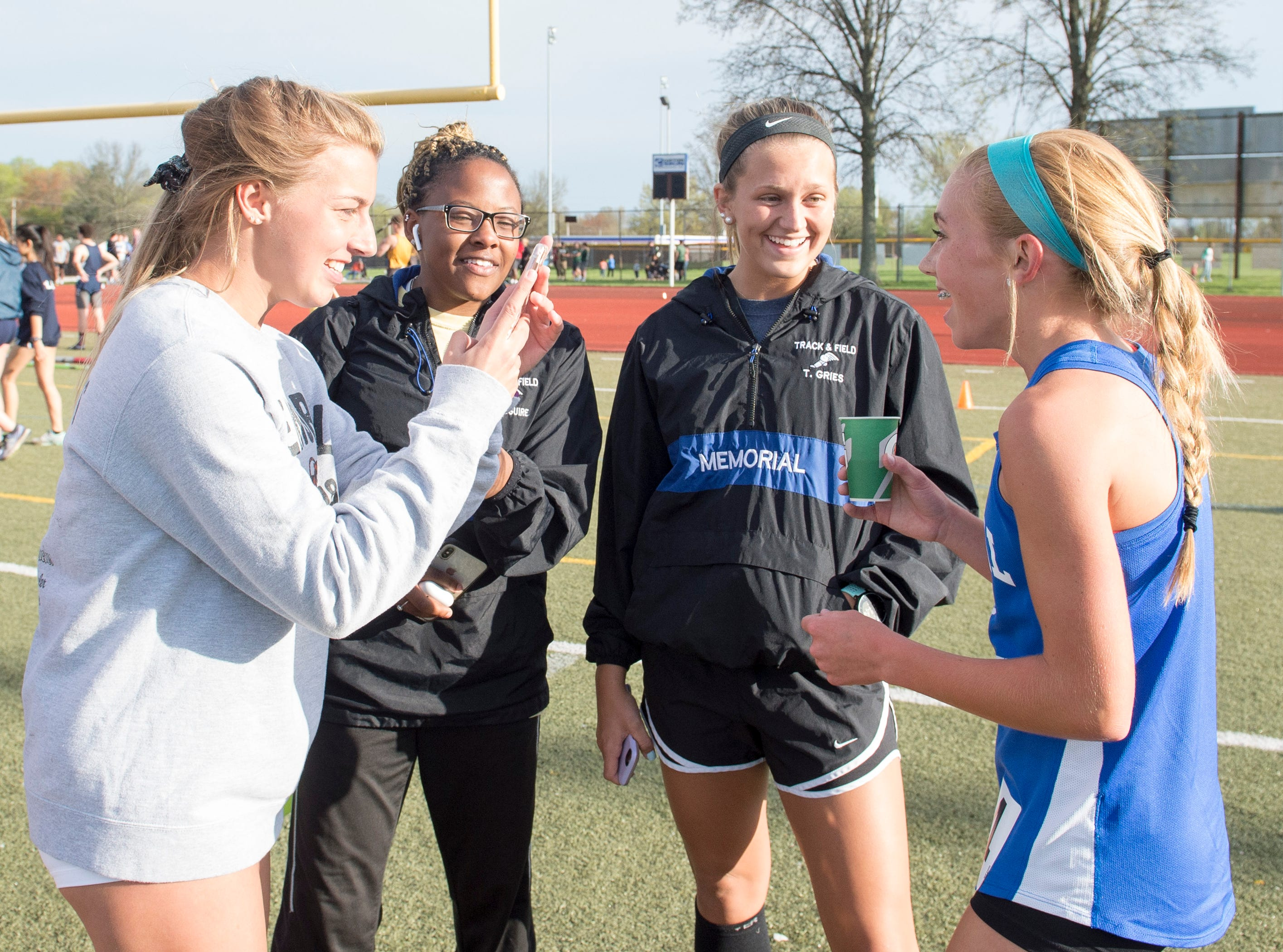 Memorial's Jacqueline Brasseale, far right, celebrates with teammates during the 2019 City Track and Field meet at Central high School Friday, April 12, 2019. Brasseale placed first in the event at five minutes and 18.21 seconds