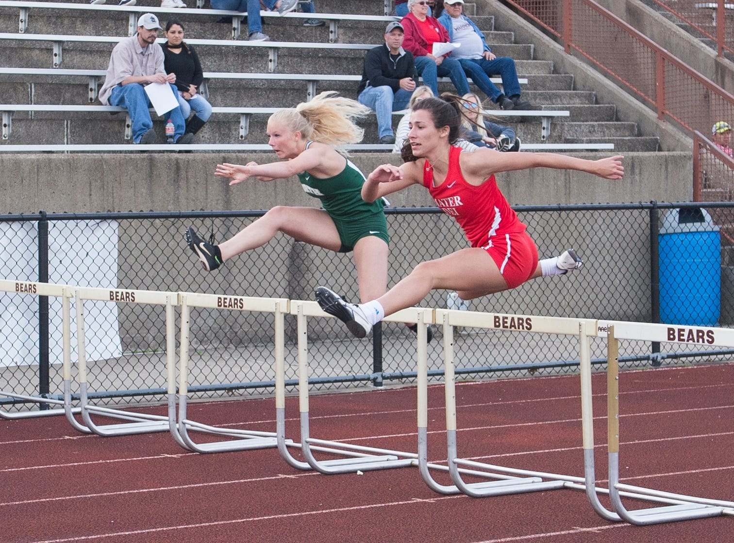 Mater Dei's Victoria Zigenfus (red) clears a hurdle in the girls 100m low hurdle event during the 2019 City Track and Field meet at Central High School Friday, April 12, 2019. Zingenfus won first place in the event at 16.41 seconds.