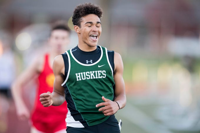 North's Drake Dickens celebrates after finishing first in boys 800m run during the 2019 City Track and Field meet at Central High School Friday, April 12, 2019.
