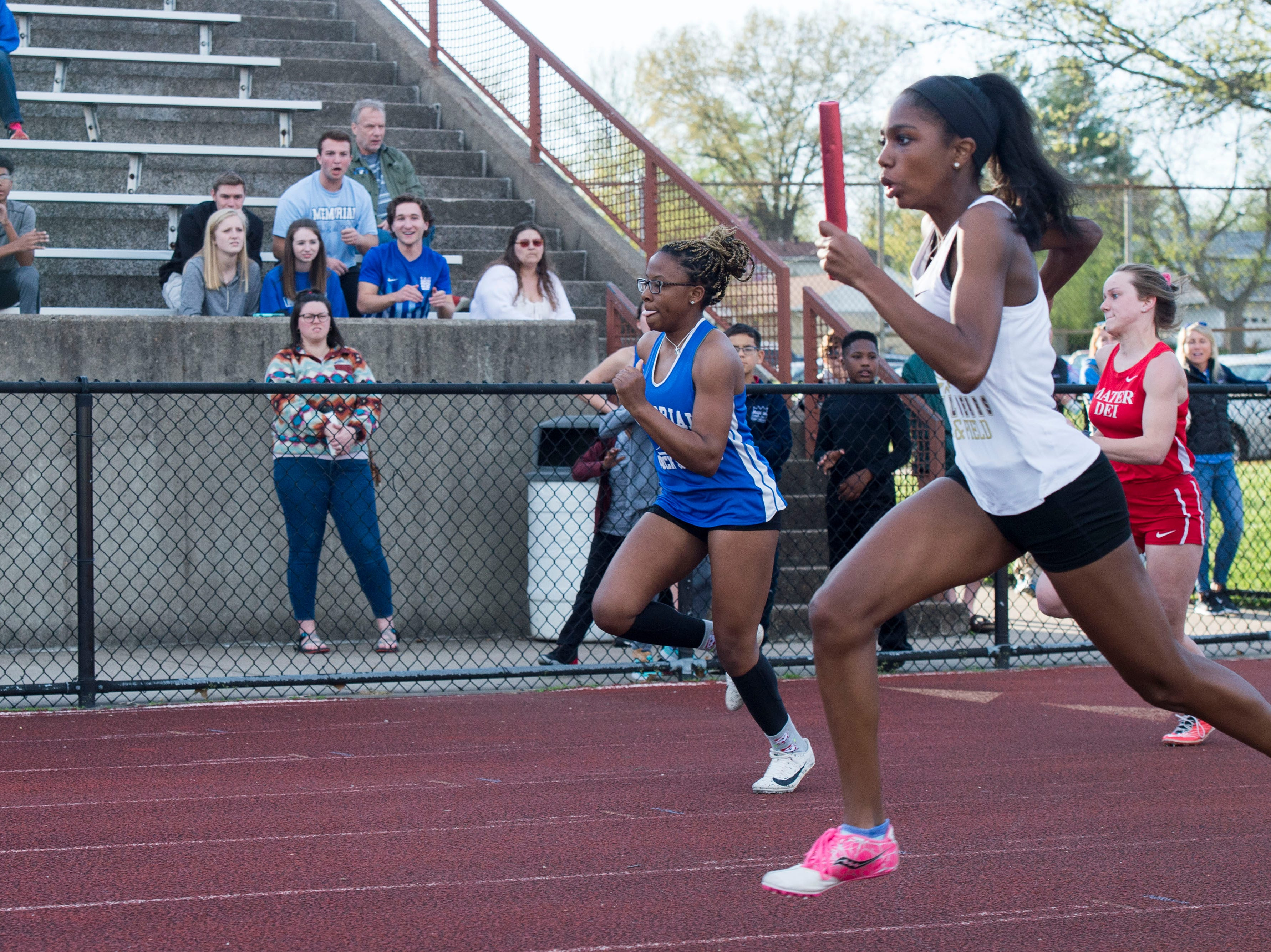 Central's Jayria Stinson gains speed in the last stretch of the girls 400m relay during the 2019 City Track and Field meet at Central High School Friday, April 12, 2019.