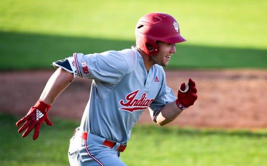 Indiana University's Elijah Dunham (21) sprints toward first base as the Evansville Aces play Indiana University at Evansville's Braun Stadium April 12, 2019.