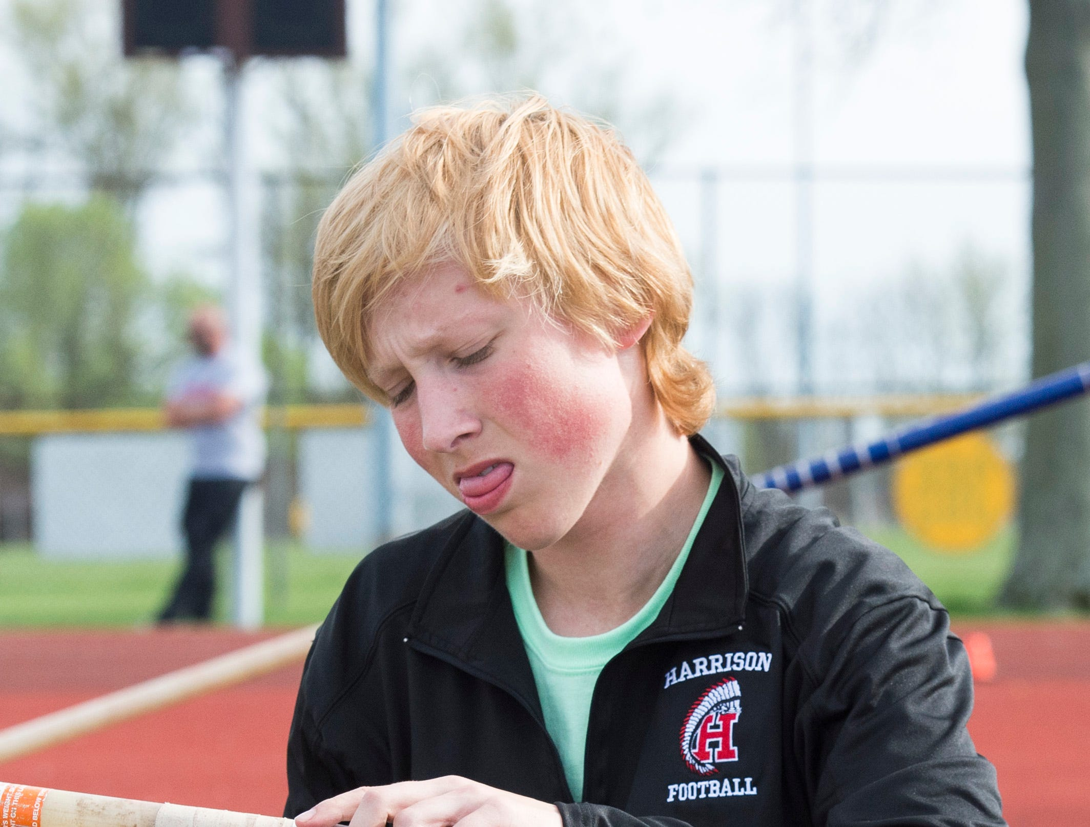 Harrison's Evan Doan tapes his pole before the 2019 City Track and Field meet at Central High School Friday, April 12, 2019.