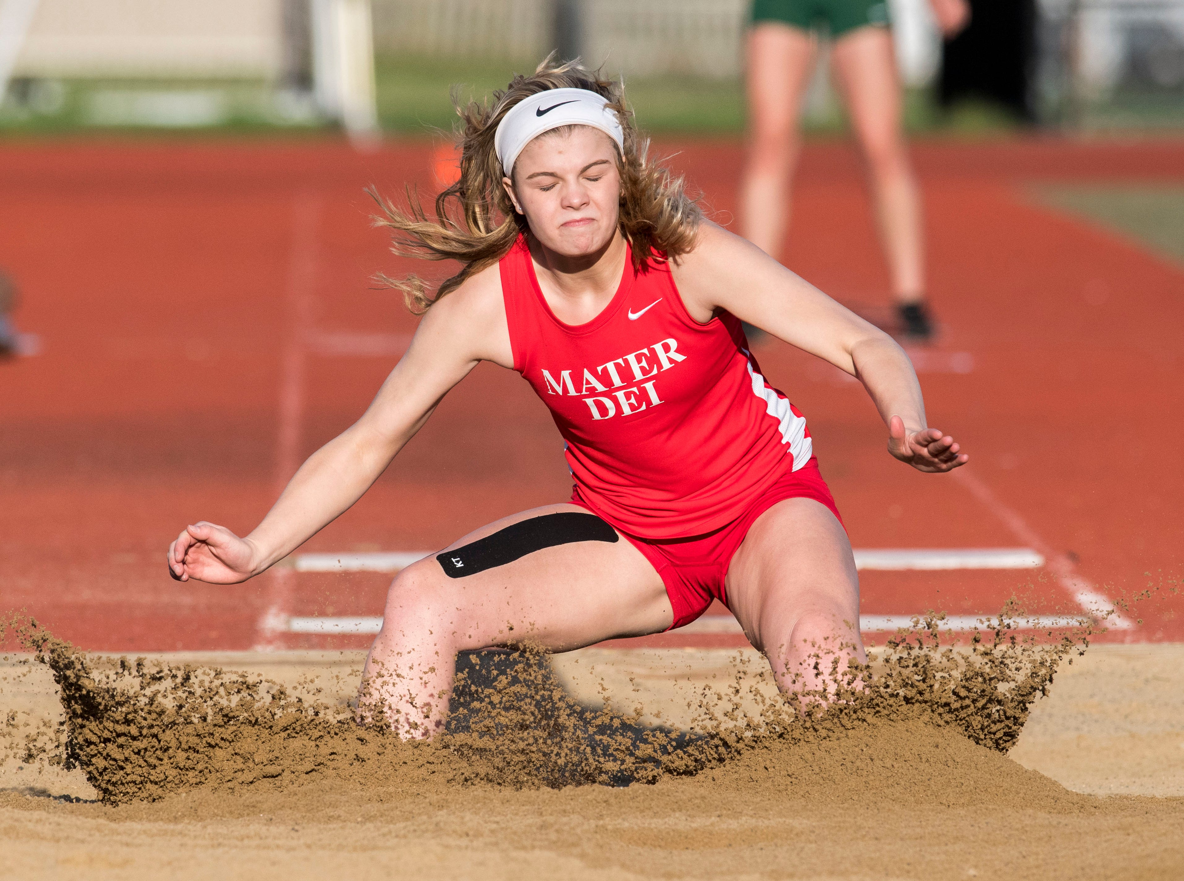 Mater Dei's Audrey Vibbert lands in the pit after a jump during the 2019 City Track and Field meet at Central High School Friday, April 12, 2019.
