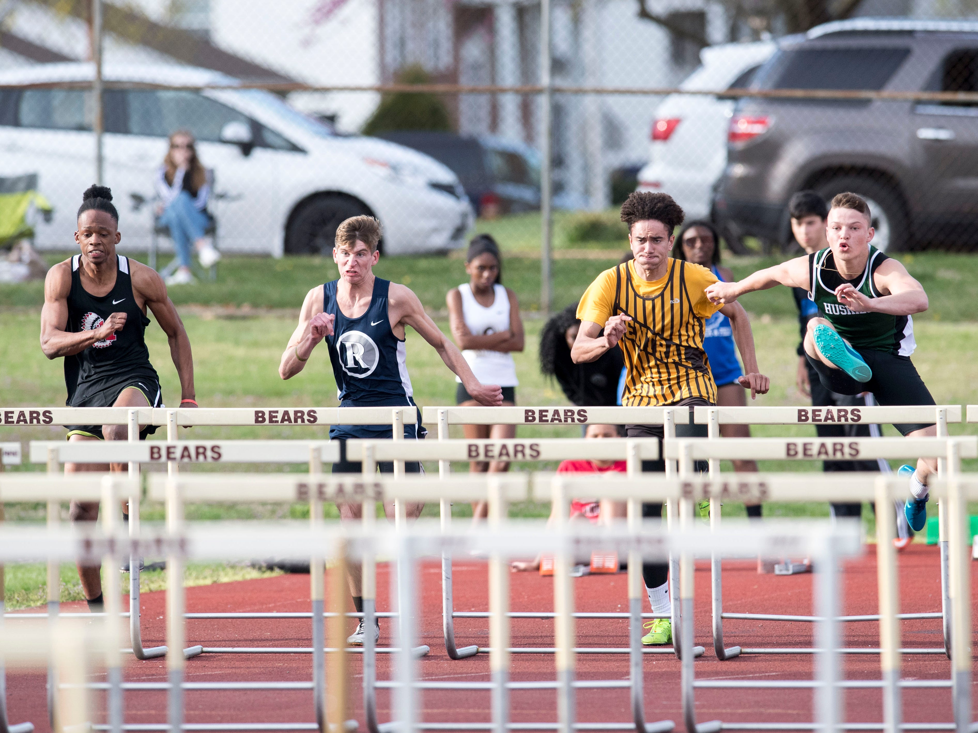 Runners take off in the boys 110m high hurdle event during the 2019 City Track and Field meet at Central High School Friday, April 12, 2019.