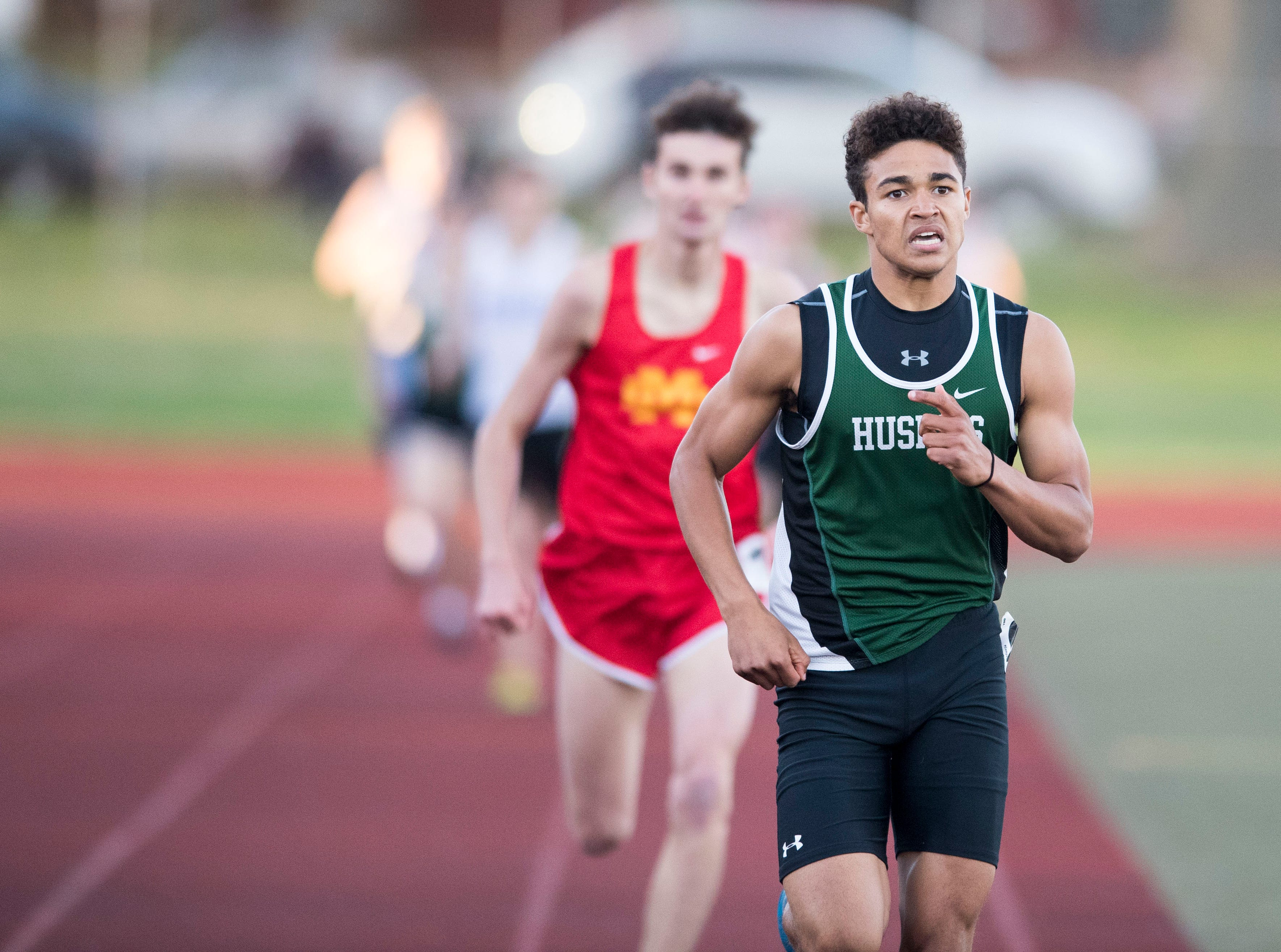 North's Drake Dickens leads in the boys 800m run during the 2019 City Track and Field meet at Central High School Friday, April 12, 2019.