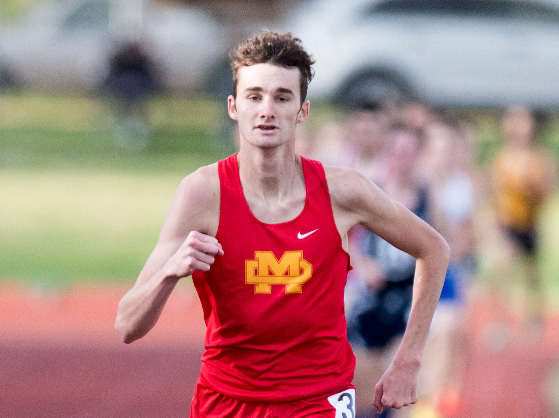 Mater Dei's Tanner Schickel puts a heavy gap between him and other runners in the boys 1600m run event during the 2019 City Track and Field meet at Central high School Friday, April 12, 2019. Schickel placed first in the event at four minutes and 35.55 seconds.