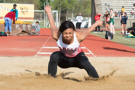 Bosse's Tionne Brigham lands in the pit during the 2019 City Track and Field meet at Central High School Friday, April 12, 2019.