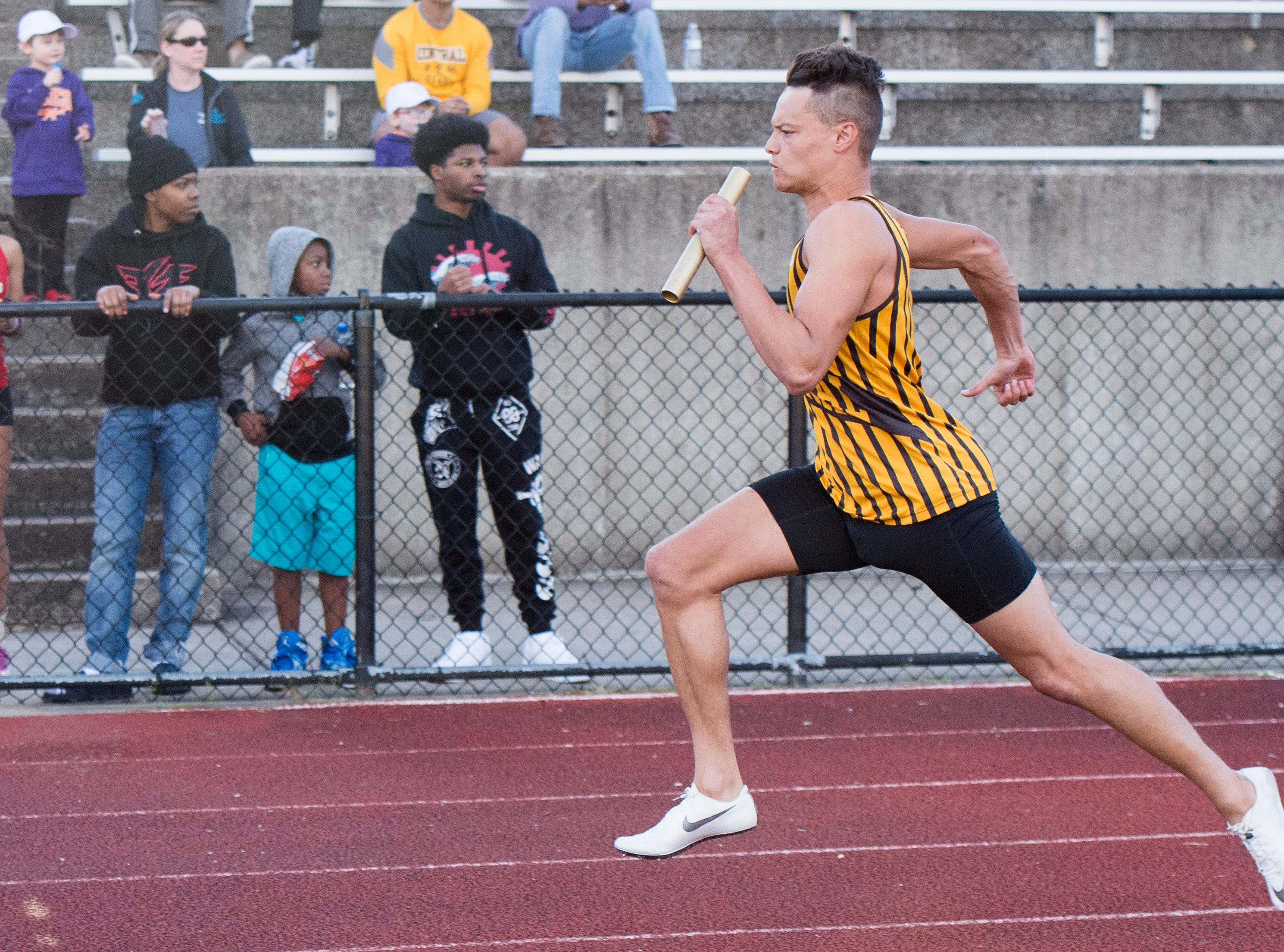 Central's Jalen Bowman spends ahead of the rest in the last stretch of the boys 400m relay event during the 2019 City Track and Field meet at Central High School Friday, April 12, 2019.